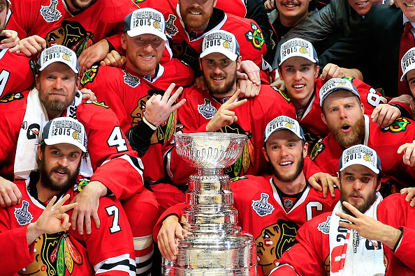 The Blackhawks stage the traditional postgame picture around the Stanley Cup (Getty Images).