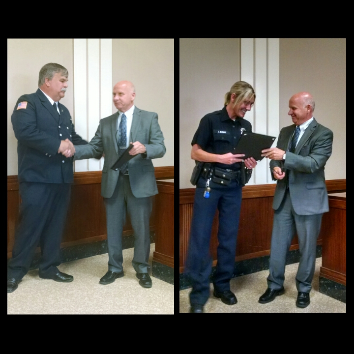 Firefighter Brendan Finn, left, and police officer Joanne Davis were presented with proclamations by Village of Kenmore Mayor Pat Mang on June 16 for leading the occupants of a burning home to safety on June 10.