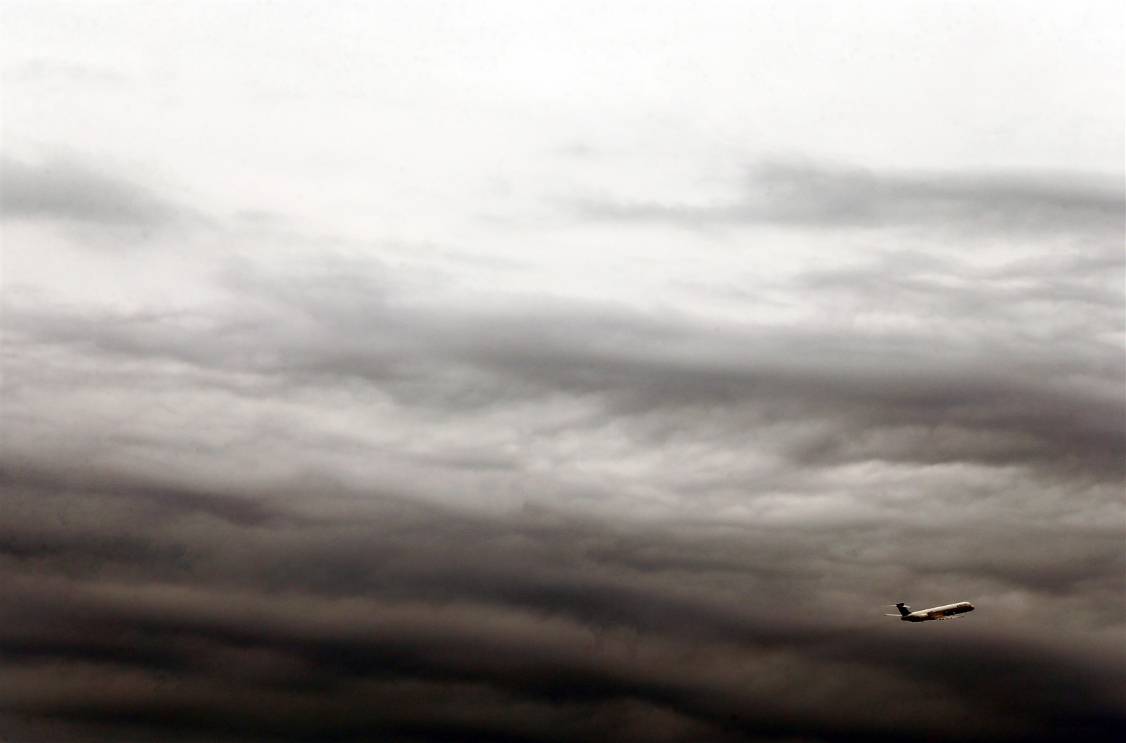 A plane takes off from the Buffalo Niagara International airport just before a storm in Cheektowaga.