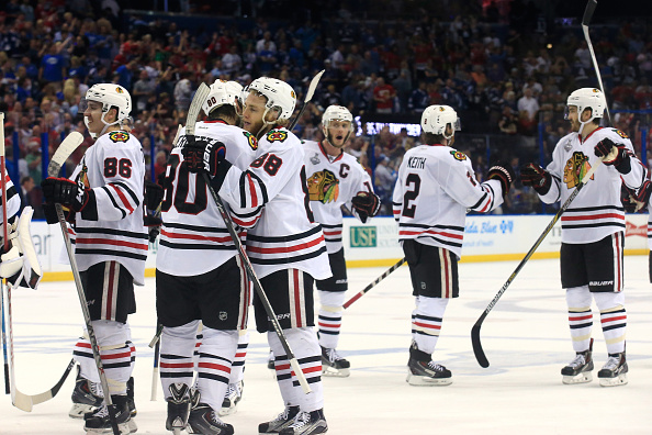 Patrick Kane (88) and Antoine Vermette (80) are among the Blackhawks celebrating Saturday's win. (Getty Images)