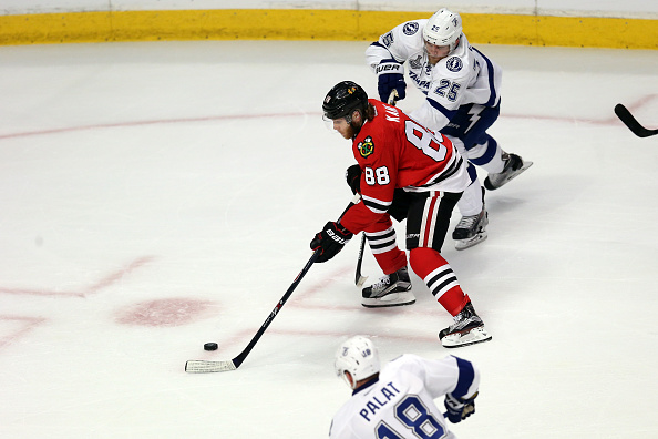 Patrick Kane, being checked by Tampa Bay's Matt Carle (25) and Ondrej Palat (18) hasn't had a lot of open ice in the series (Getty Images).