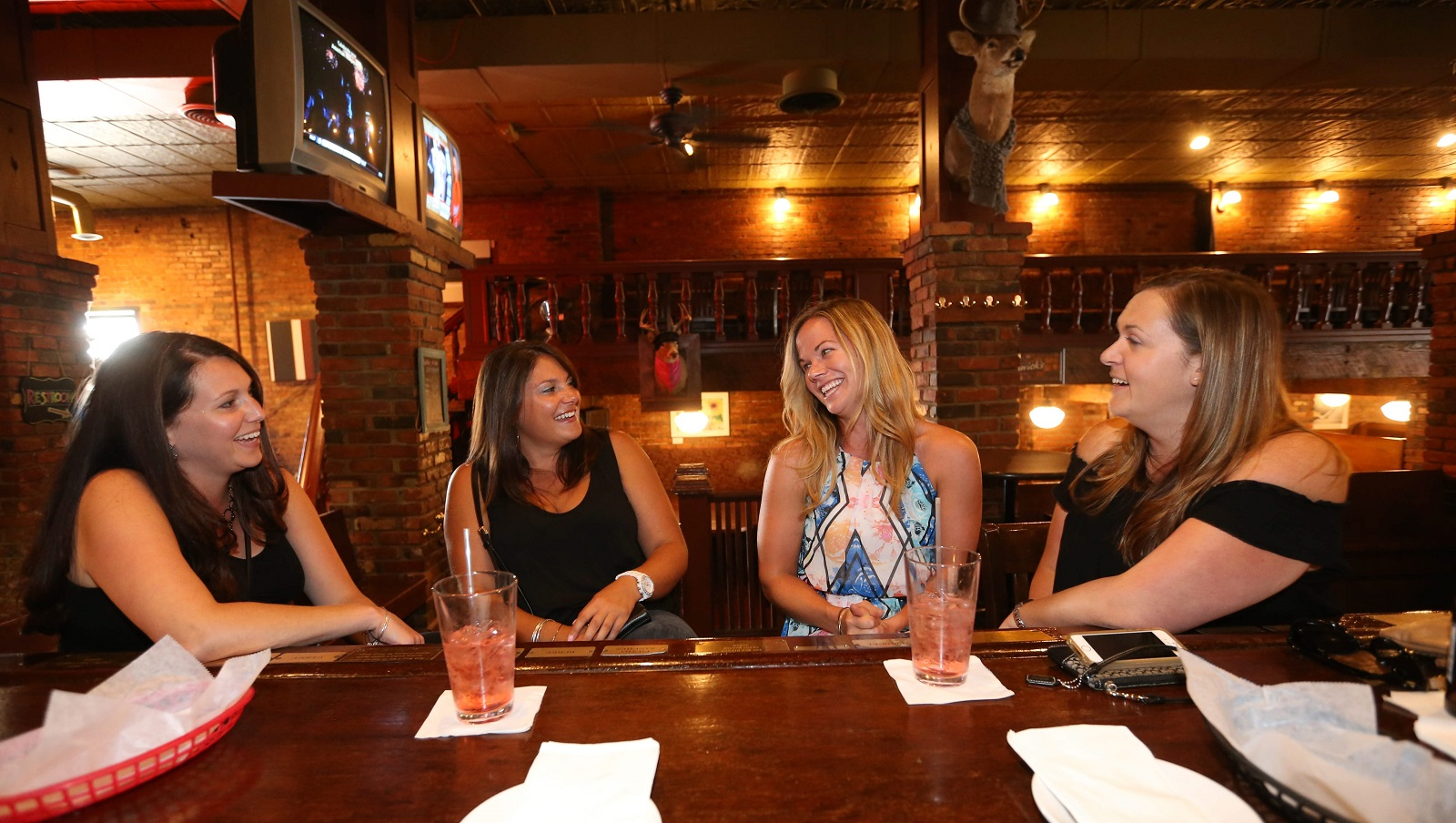 Christina Scovazzo, left, Nicole Rossney, Misty Hofert and Kiera Campbell hang out during happy hour at Century Grill in downtown Buffalo. (Sharon Cantillon/Buffalo News)