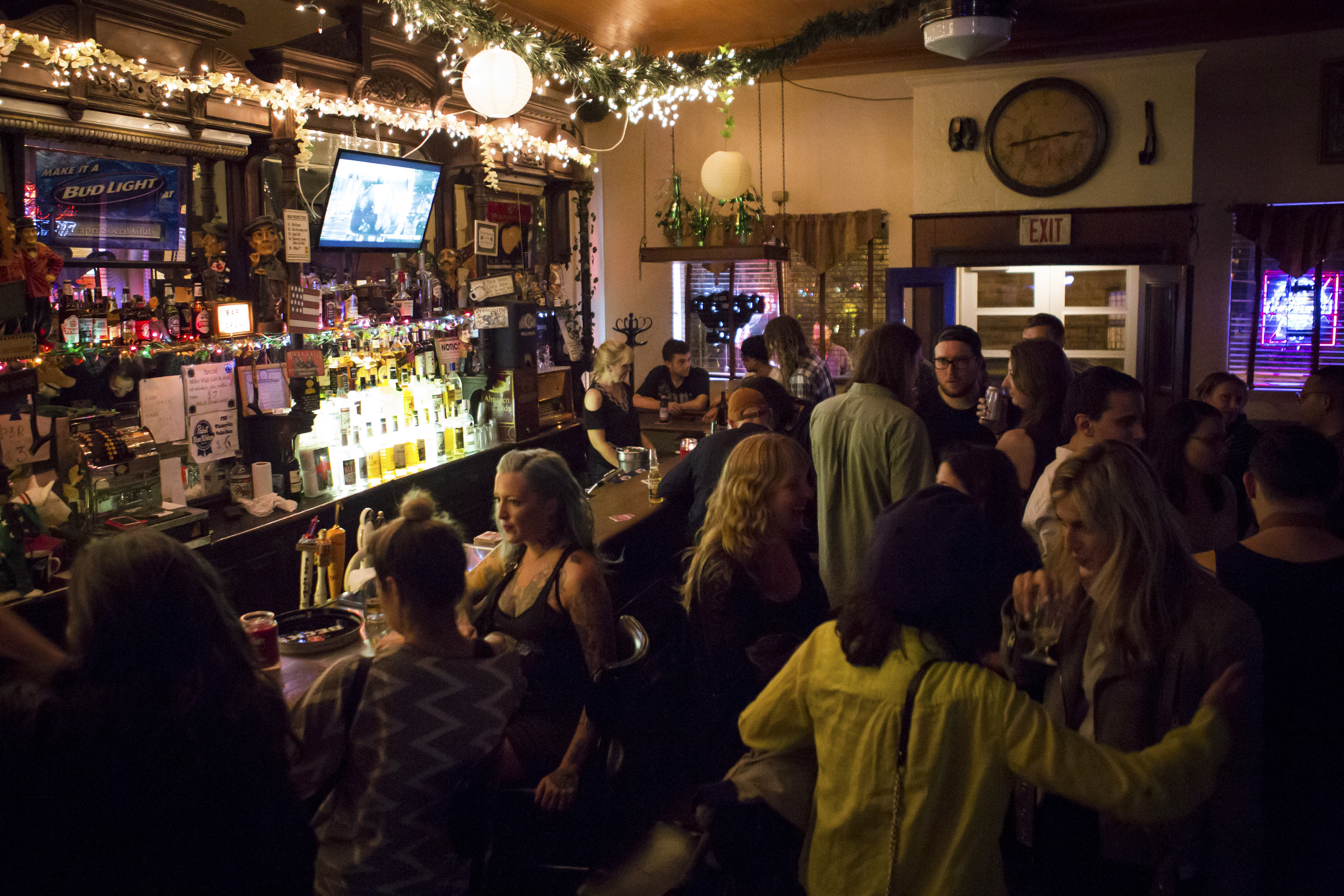 The crowd packs the Capri Social Club in the Greenpoint neighborhood of New York City. The bar's minimalism has made it appealing to television and film production crews.