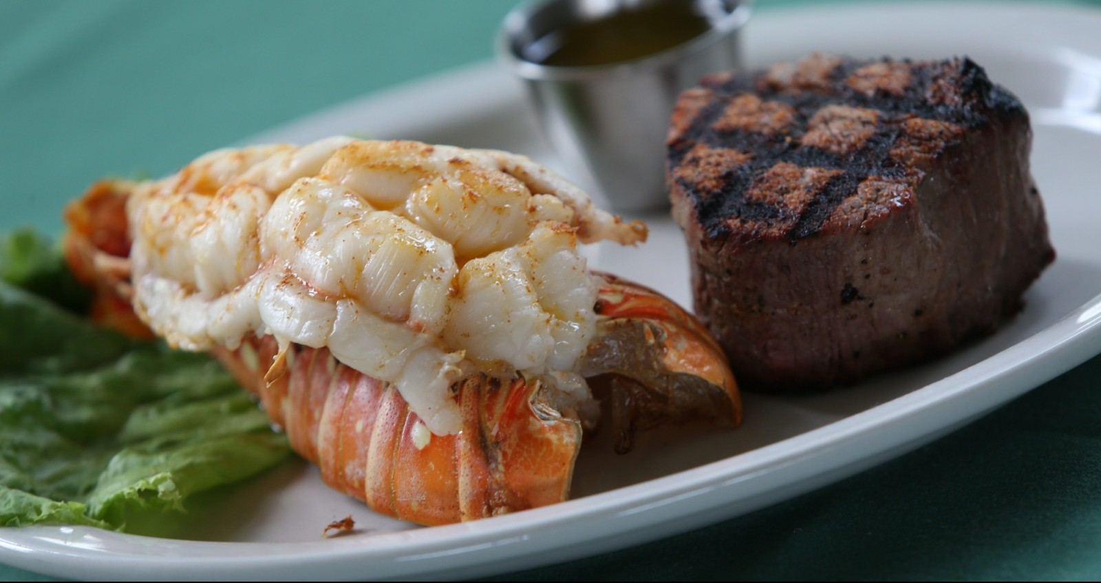 The surf and turf is one of the most popular dishes at Danny Sheehan's. It comes with a 6-ounce filet mignon and an 8-ounce lobster tail, twice-baked potato and garlic toast.  A 10-ounce NY strip is available in instead of the filet mignon. (Sharon Cantillon/Buffalo News)