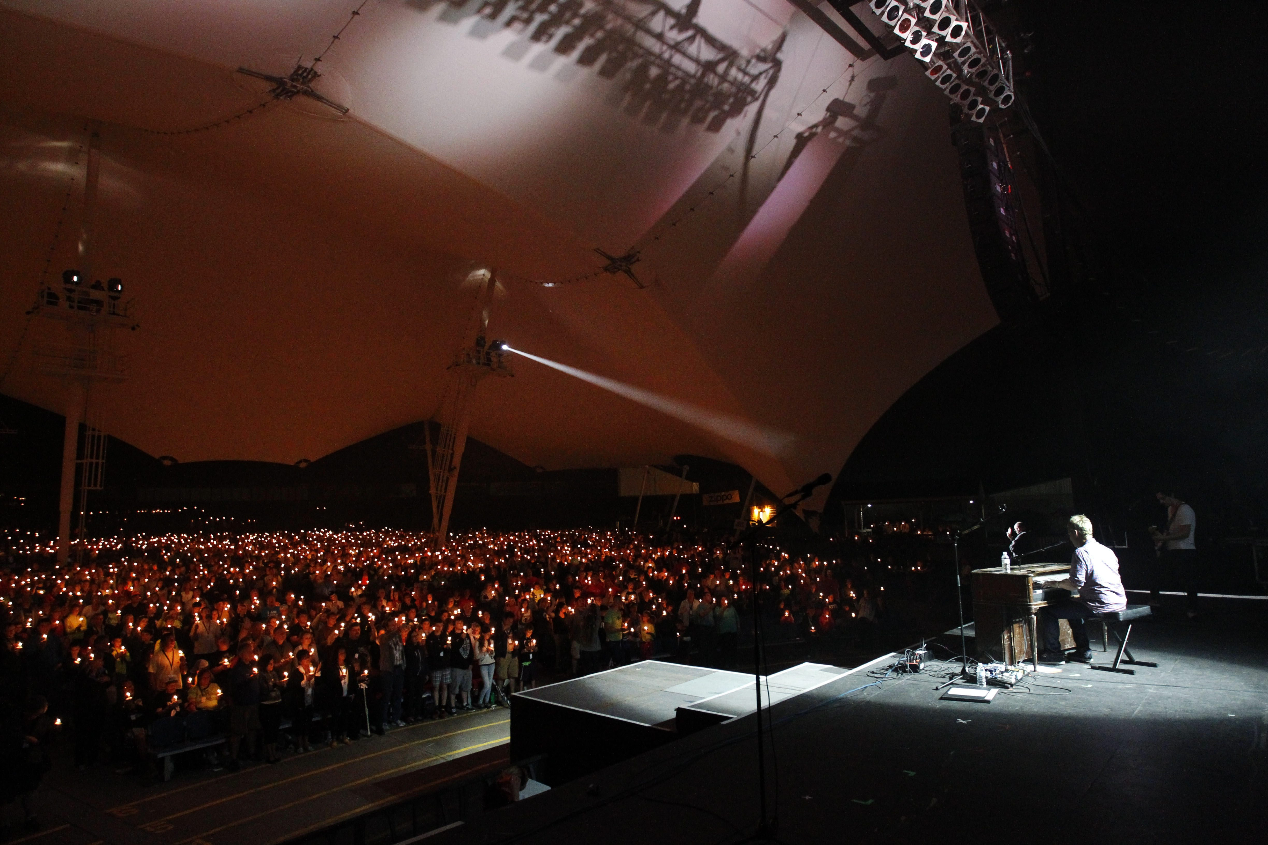 Singer-songwriter Steven Curtis Chapman performs as audience members hold up candles at last year's Kingdom Bound Christian music festival at Darien Lake.