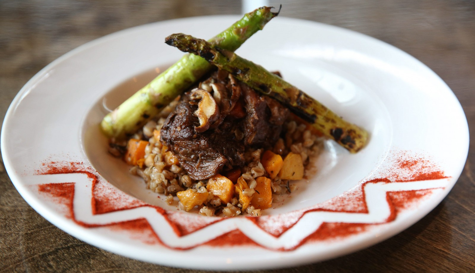 Eight-hour red wine braised short ribs served over a faro risotto with roasted butternut squash, sauteed mushrooms, fresh sage, garlic and fresh grated Parmesan. (Sharon Cantillon/Buffalo News)