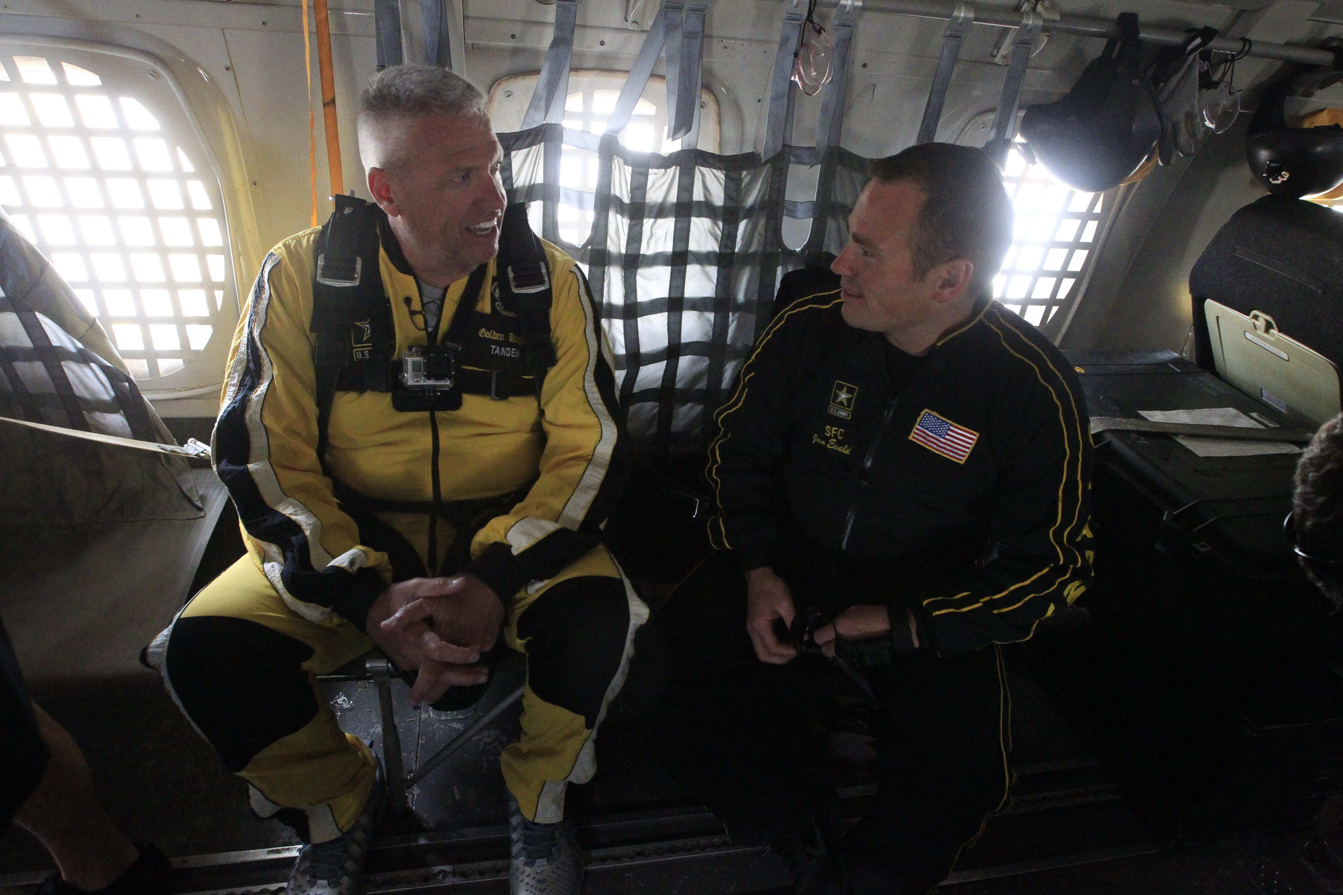 Bills coach Rex Ryan chats with U.S. Army Sgt. First Class Jon Ewald before their tandem jump with the U.S. Army Golden Knights.