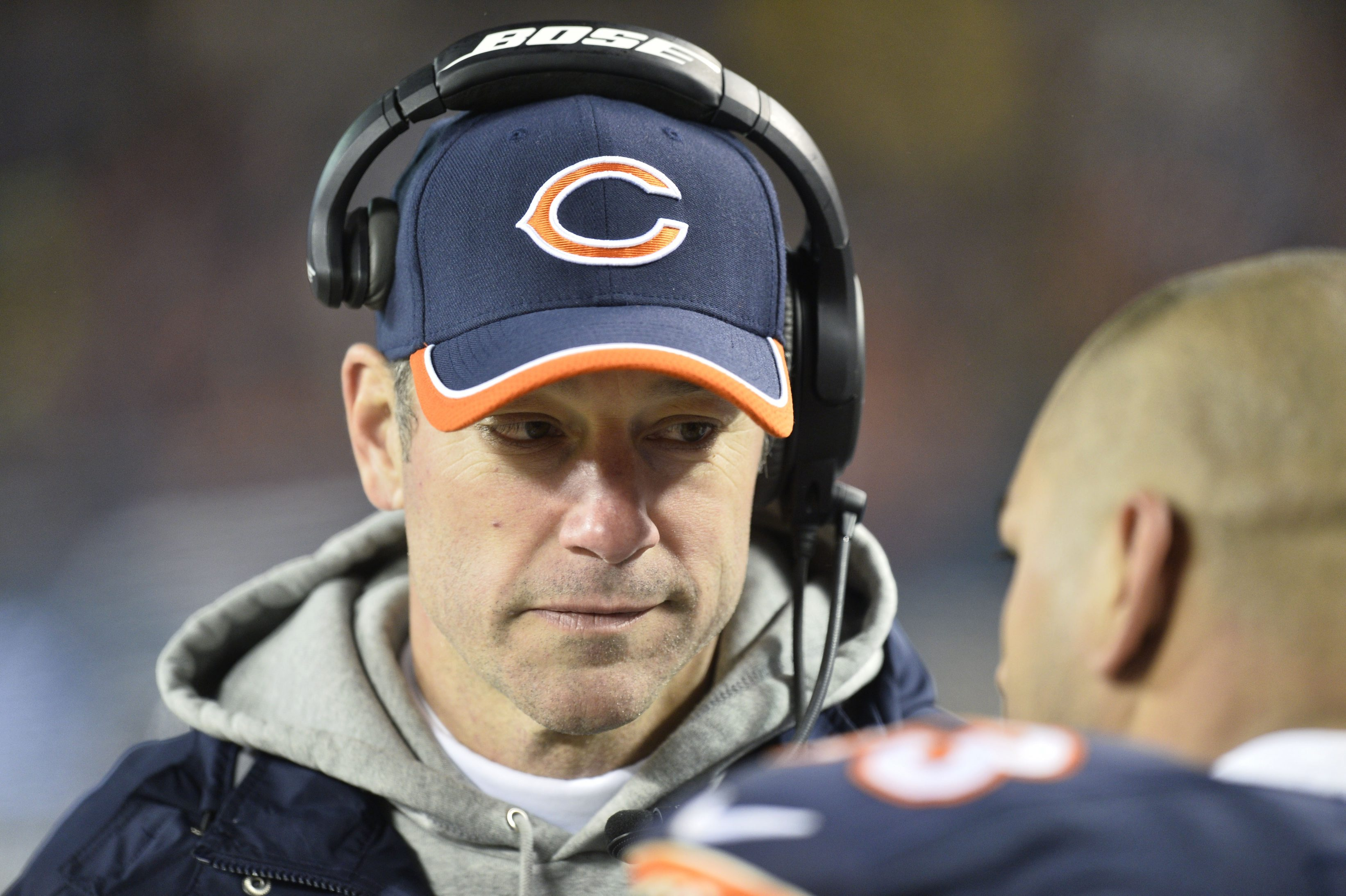CHICAGO, IL - DECEMBER 15: Offensive coordinator Aaron Kromer of the Chicago Bears talks with a player on the sideline during the third quarter at Soldier Field on December 15, 2014 in Chicago, Illinois. The Saints defeated the Bears 31-15. (Photo by Brian Kersey/Getty Images)