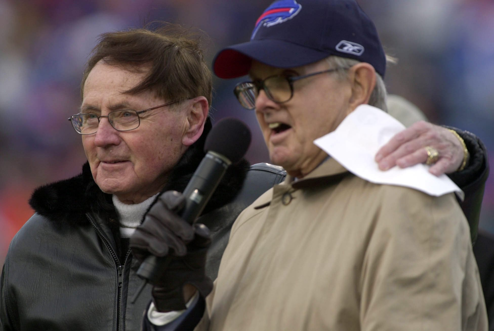 Longtime Voice of the Bills Van Miller stands with owner Ralph Wilson during a halftime ceremony celebrating is many years with the team at Ralph Wilson stadium in Orchard Park Sunday Dec 21, 2003.  This was Miller's last home broadcast.  Photo by Mark Mulville