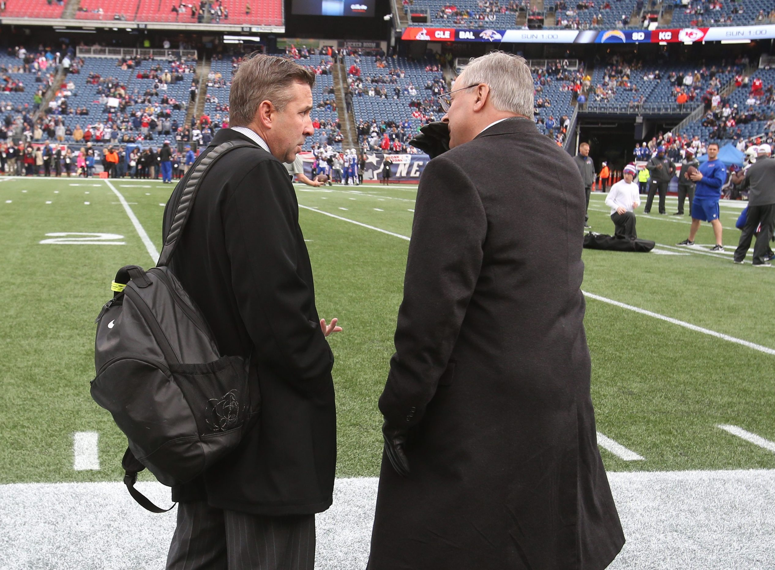 Russ Brandon, left, will now report to Terry Pegula about the football field and the hockey rink. (James P. McCoy/Buffalo News)
