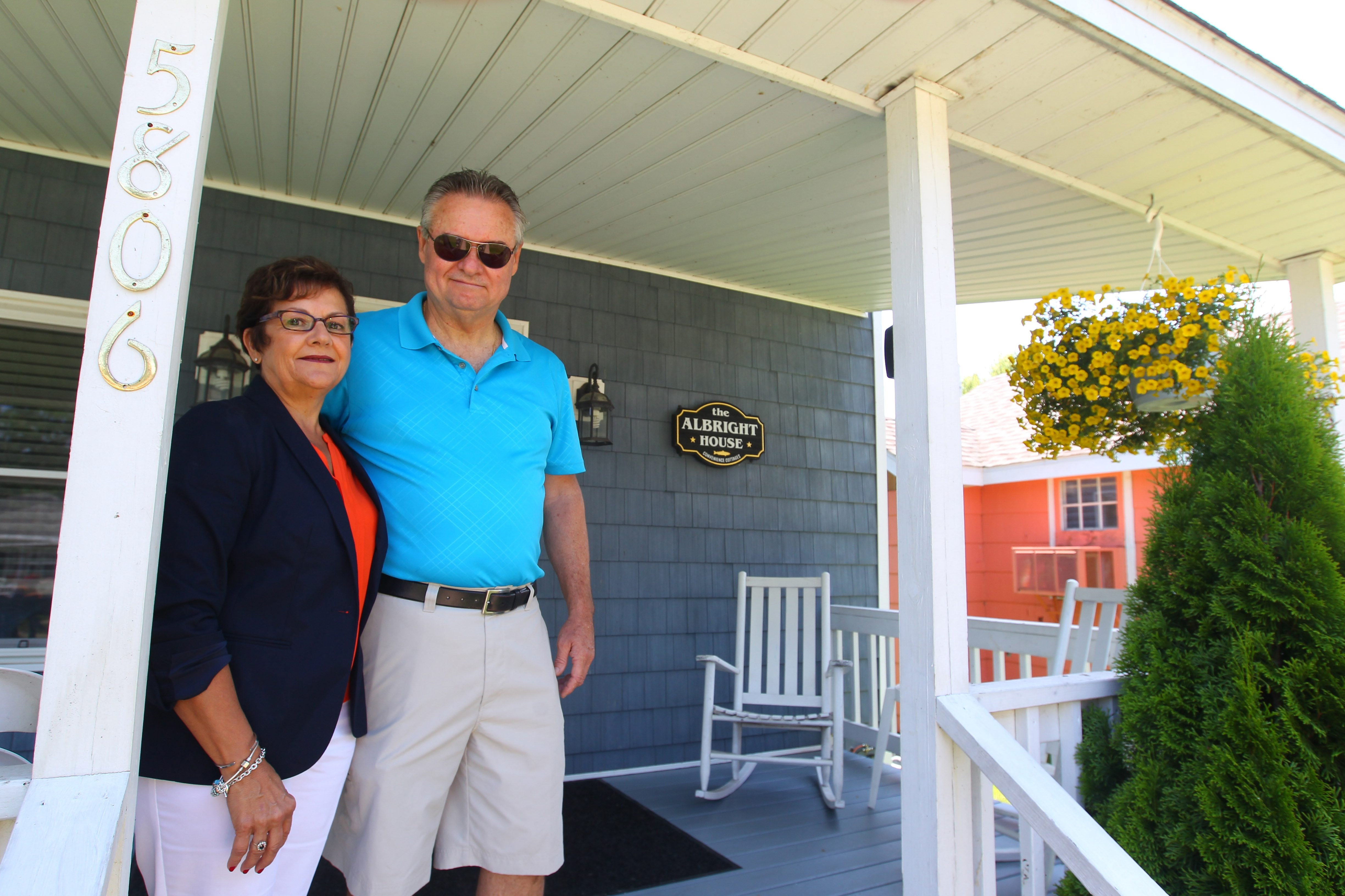 "Bev and Dan Mandaville, on the front porch of ""The Albright House,"" take pride in the five cottages they rent out – from one to five bedrooms – just steps away from Town of Newfane Marina for anyone seeking summertime escape along the Lake Ontario shore."