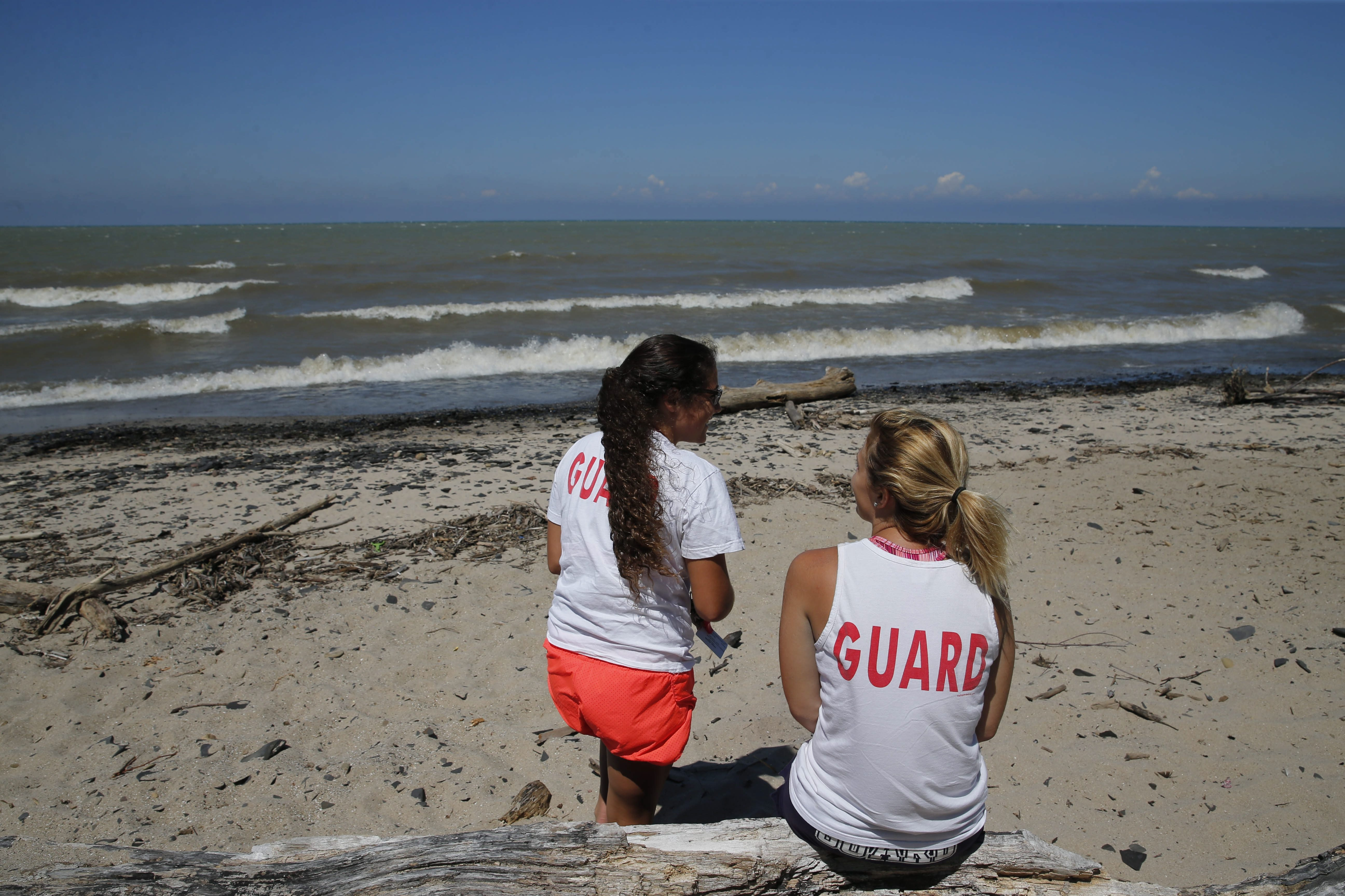 Lifeguards sit on the beach at Wendt Beach Park where Mary E. Creighton drowned last night while trying to rescue her 11-year-old daughter and another child from the rough waters of Lake Erie, Friday, July 31, 2015.  (Derek Gee/Buffalo News)