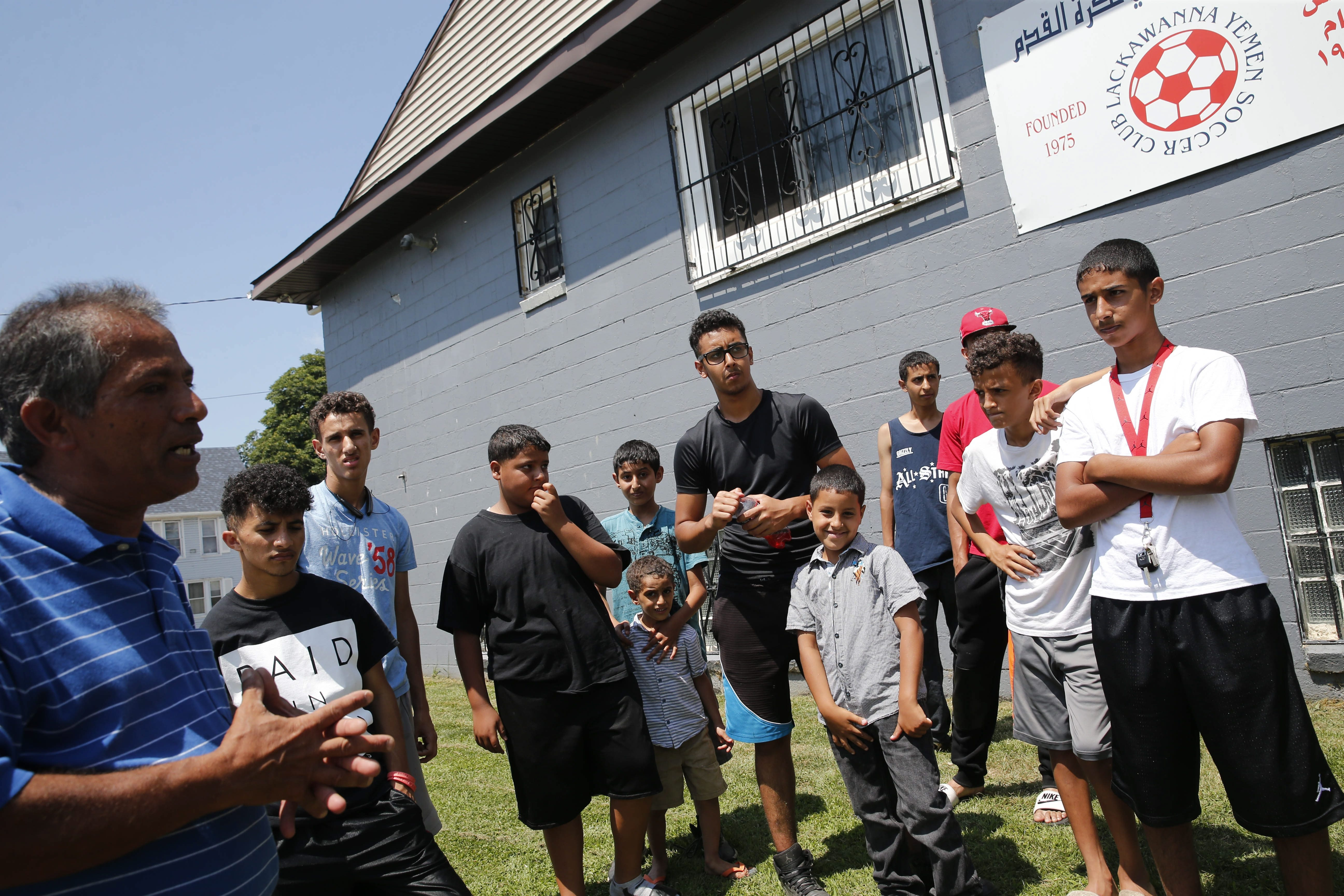 Lackawanna City Councilman Abdulsalam K. Noman, left, talks with young members of Yemen Soccer Club after arrest of Arafat M. Nagi, evoking memories of 2002 raid on Lackawanna Six.