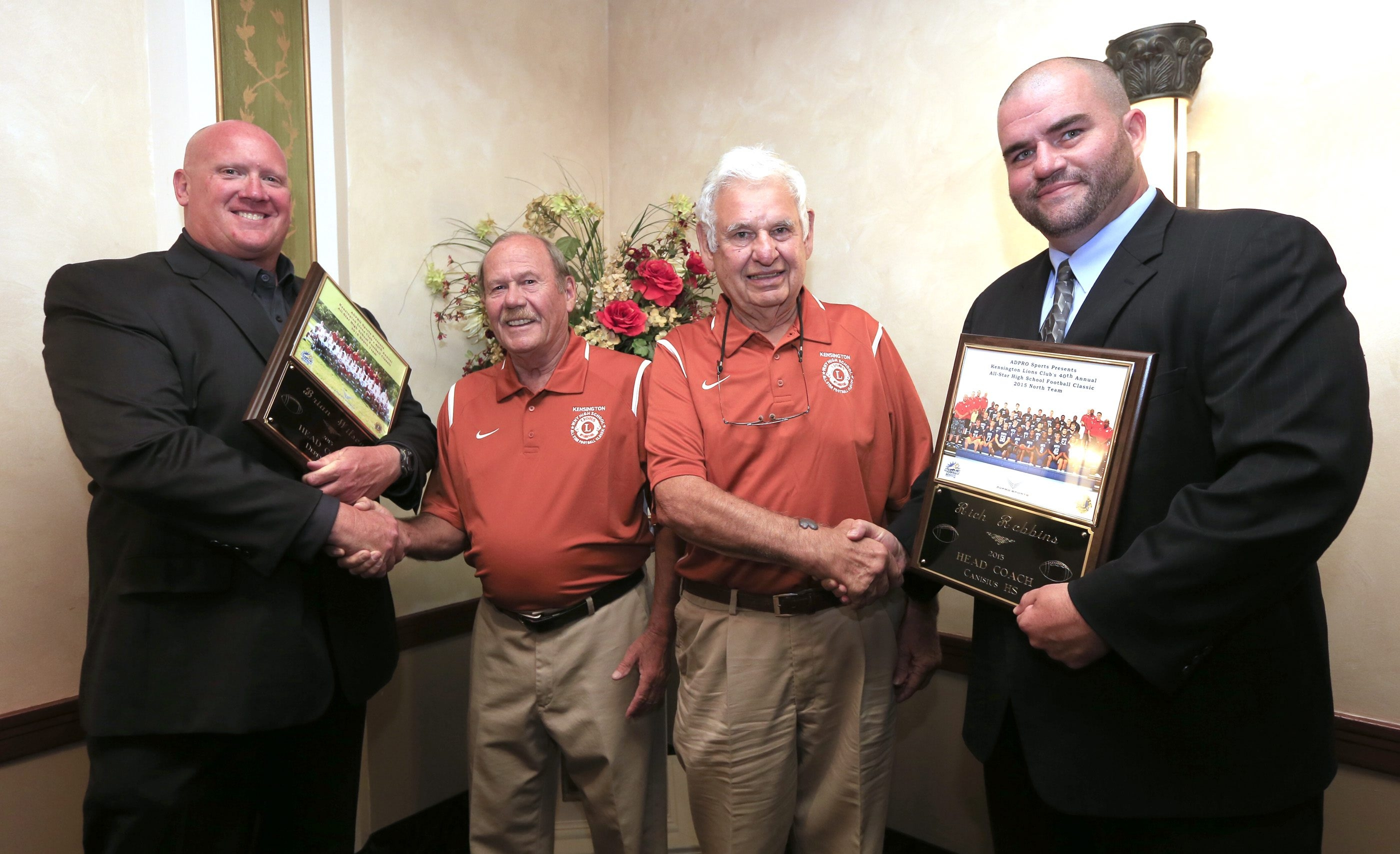 Lions Club All-Star game backers Milt Dickerson, second from left, and Gene Zinni present South coach Brian Wilson, left, and North Coach Rich Robbins, right, plaques Tuesday's at Ilio DiPaolo's restaurant.
