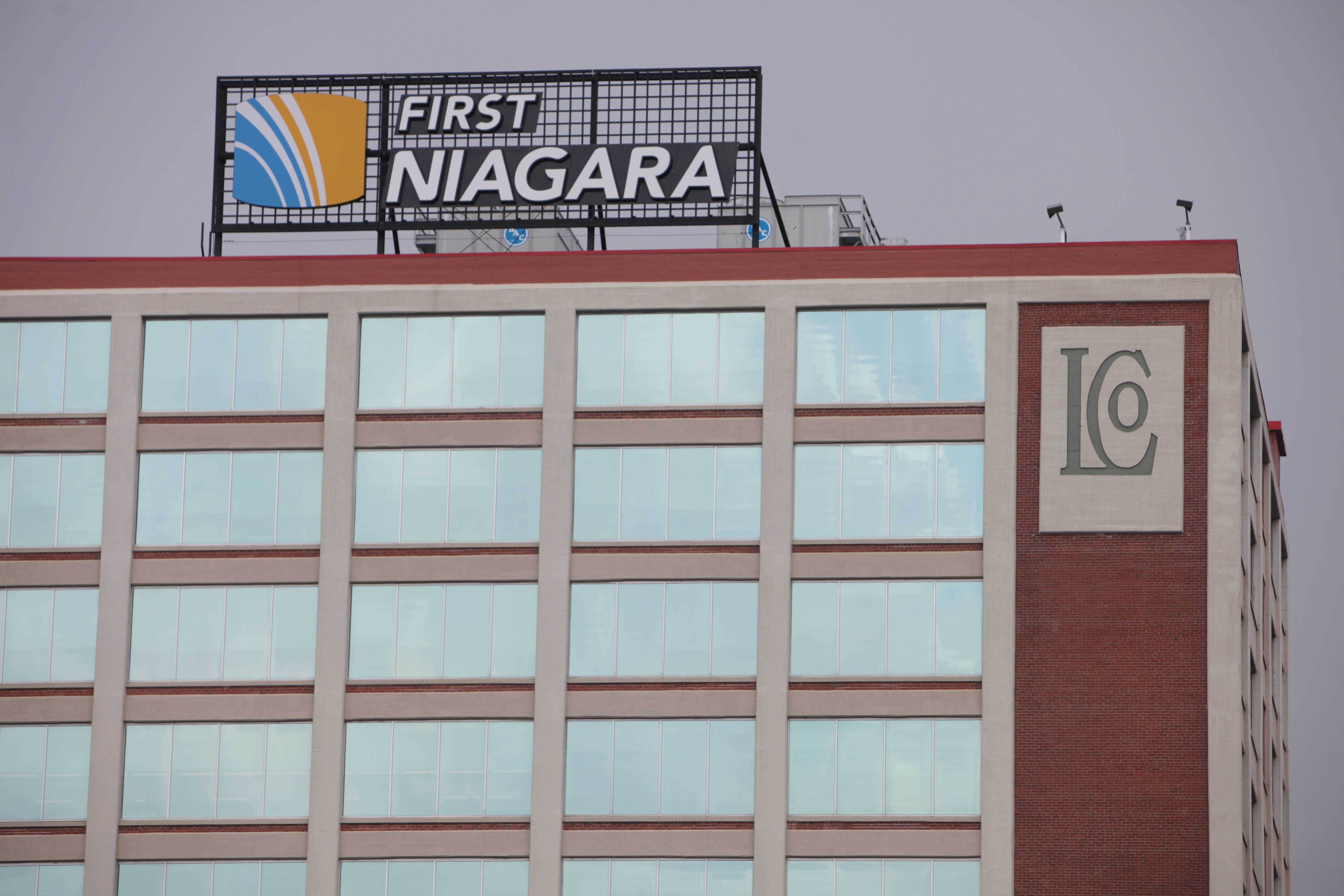 First Niagara Financial Group said the drop in its earnings is due to the impact low interest rates had on competitiveness.