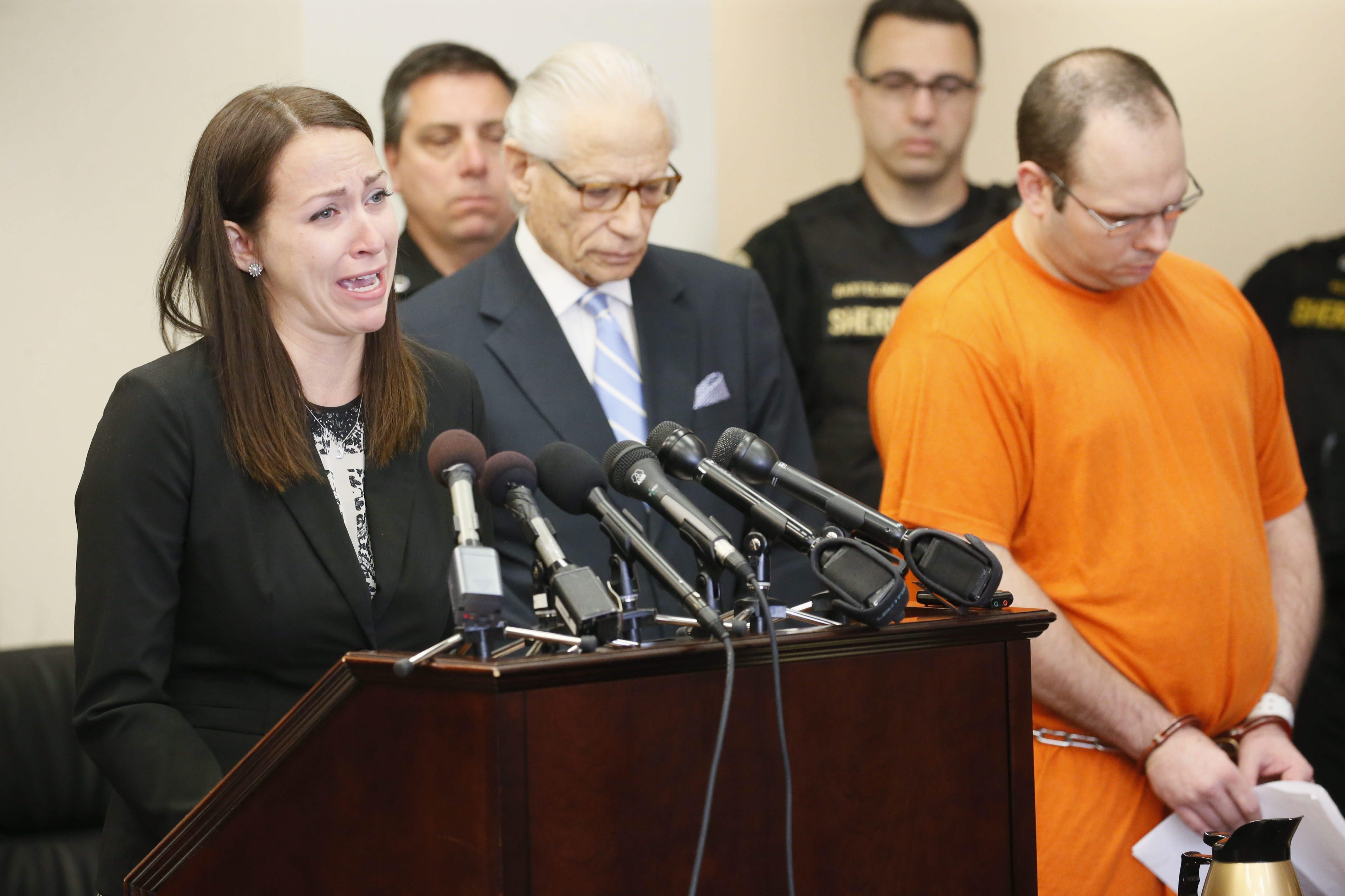 Erika Webster, fiancée of Molly's Pub homicide victim William C. Sager Jr., addresses the court, with defense attorney Joel L. Daniels and Jeffrey J. Basil alongside.