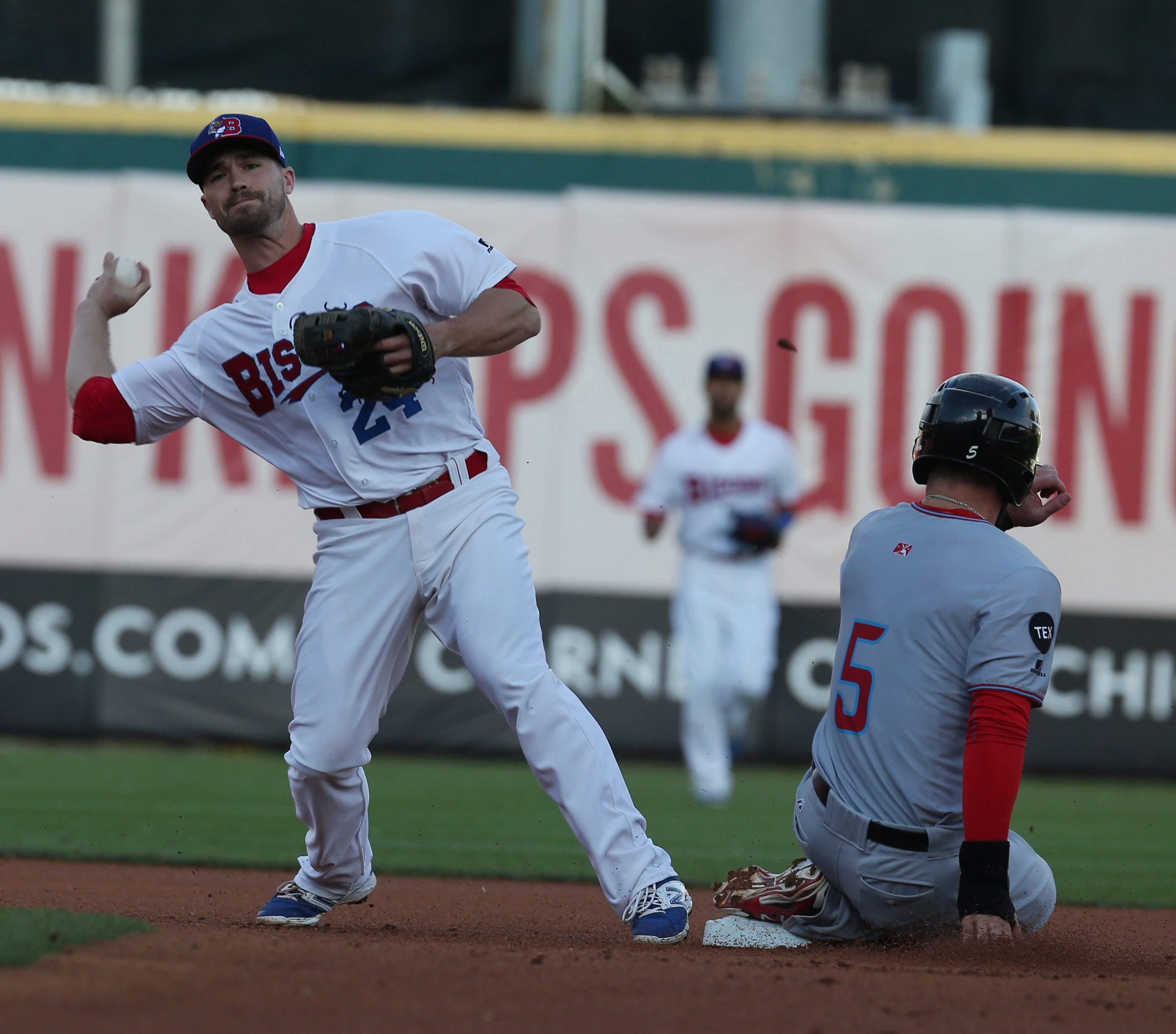 Buffalo Bisons' second baseman Jon Berti turns a double play on Syracuse's Jason Martinson in the first inning at Coca-Cola Field in Buffalo,NY on Wednesday, July 22, 2015.  (James P. McCoy/ Buffalo News)