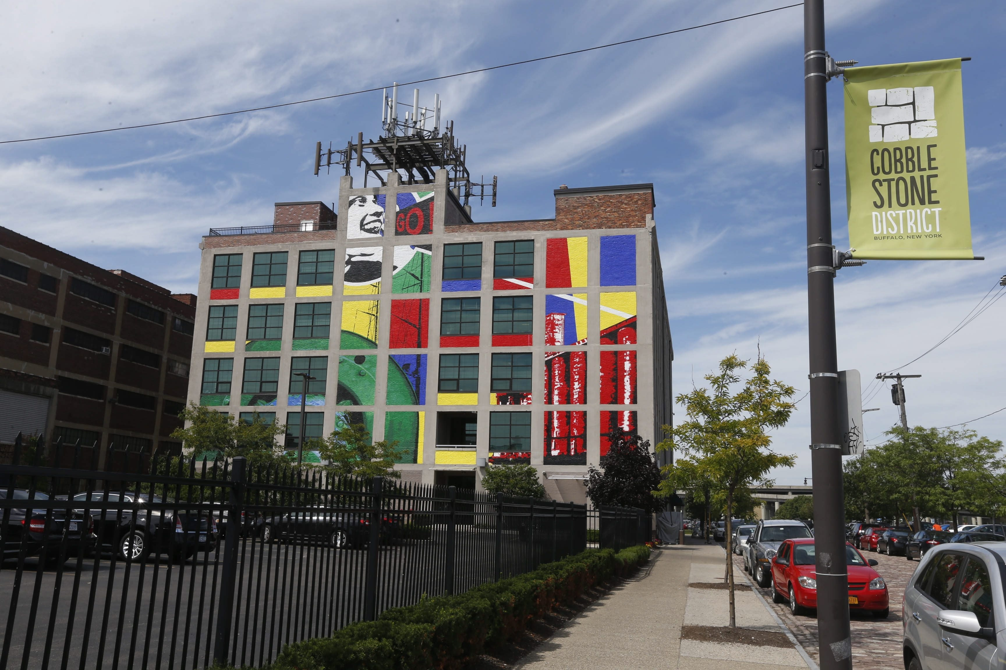 Robert Kirkham/Buffalo NewsAugustina Droze and Bruce Adams created this colorful mural on the side of 95 Perry St.