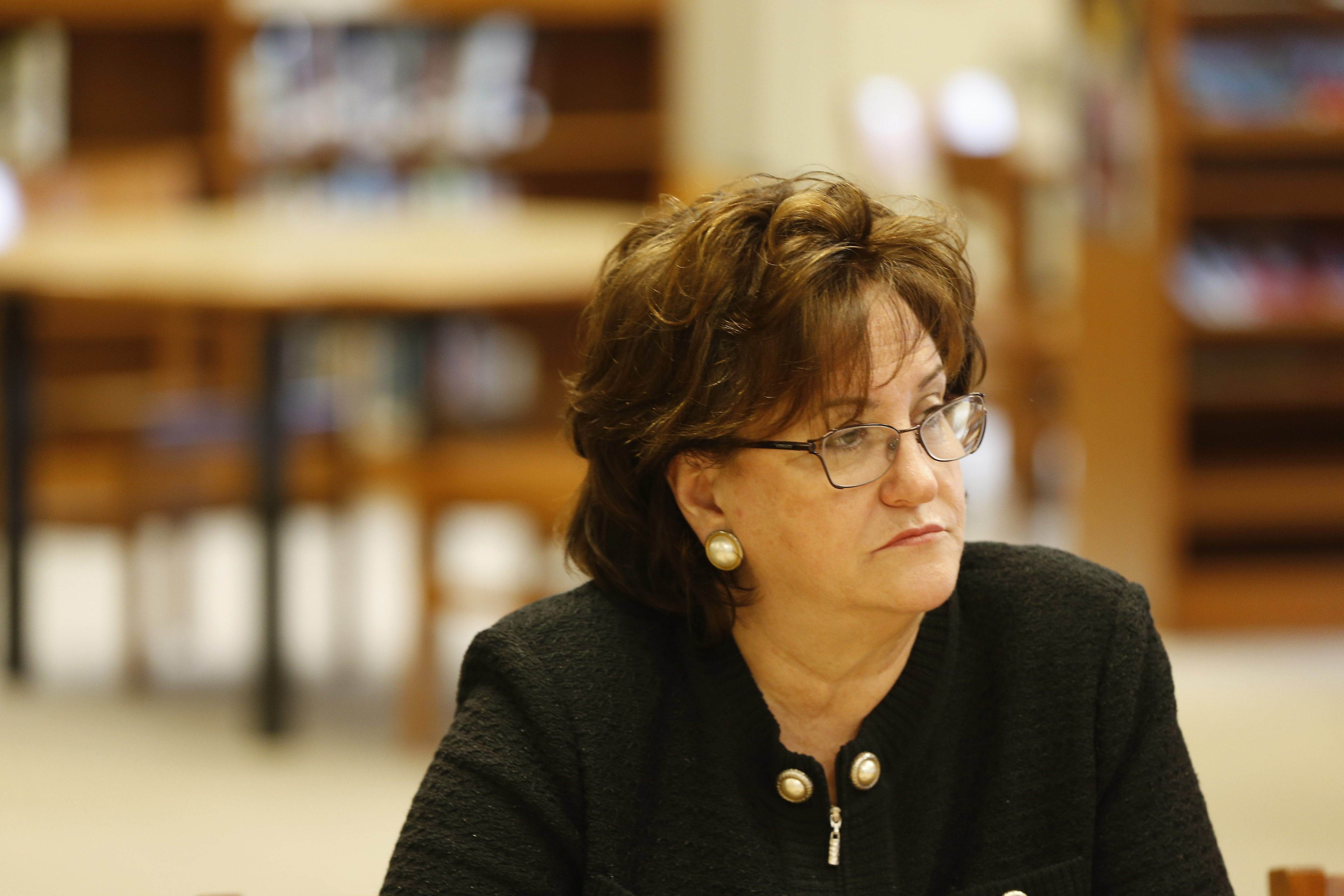 New York State Education Commissioner MaryEllen Elia talks with officials from East High School in the library at the school on July 17. (Mark Mulville/Buffalo News)