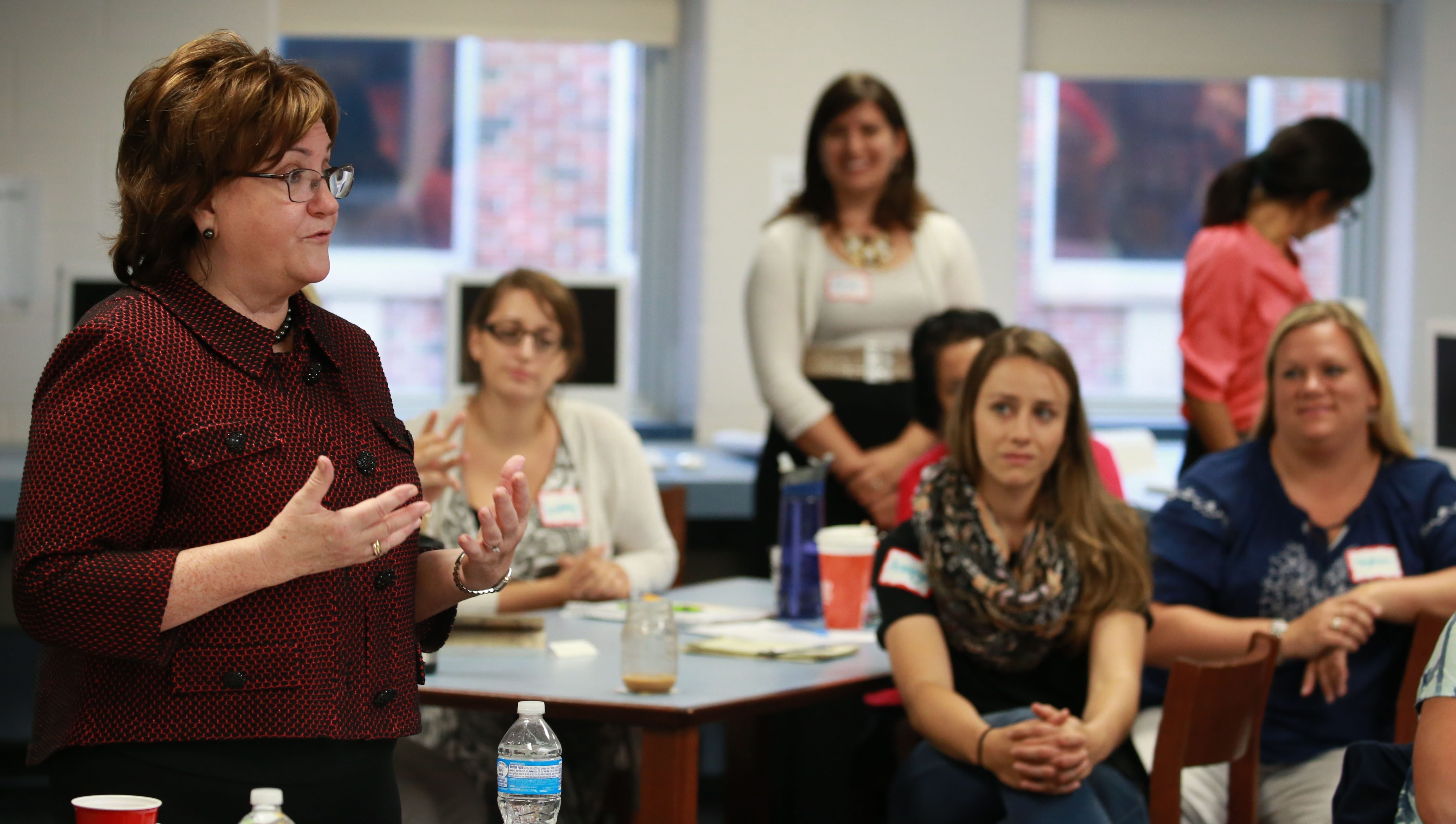 New York State Education Commissioner MaryEllen Elia talks with Sweet Home teachers at the start of her listening tour through school districts in the state. The tour ended Friday with a visit to several Buffalo schools.
