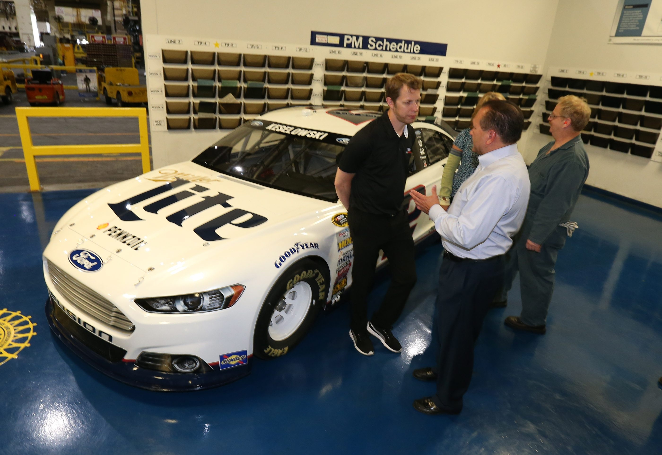 NASCAR driver Brad Keselowski talks with employees at the Ford Stamping Plant in Woodlawn on Thursday.