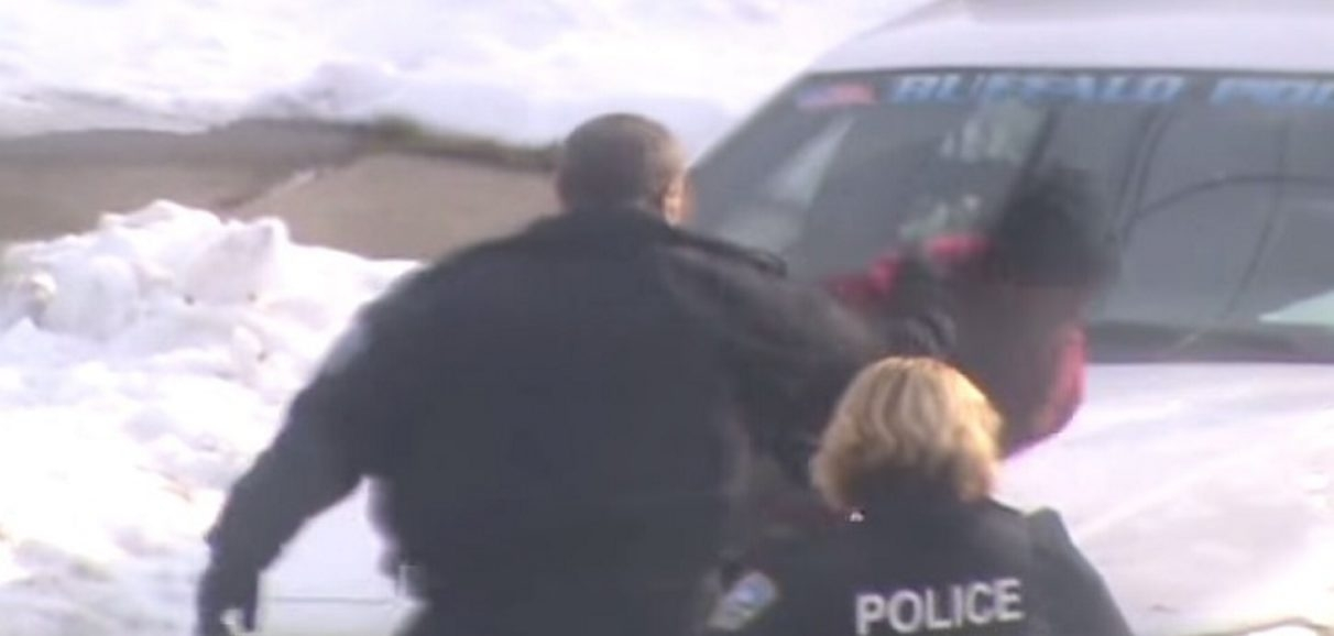 A screenshot from secretly recorded video, posted on YouTube, shows officer striking handcuffed suspect in the face.