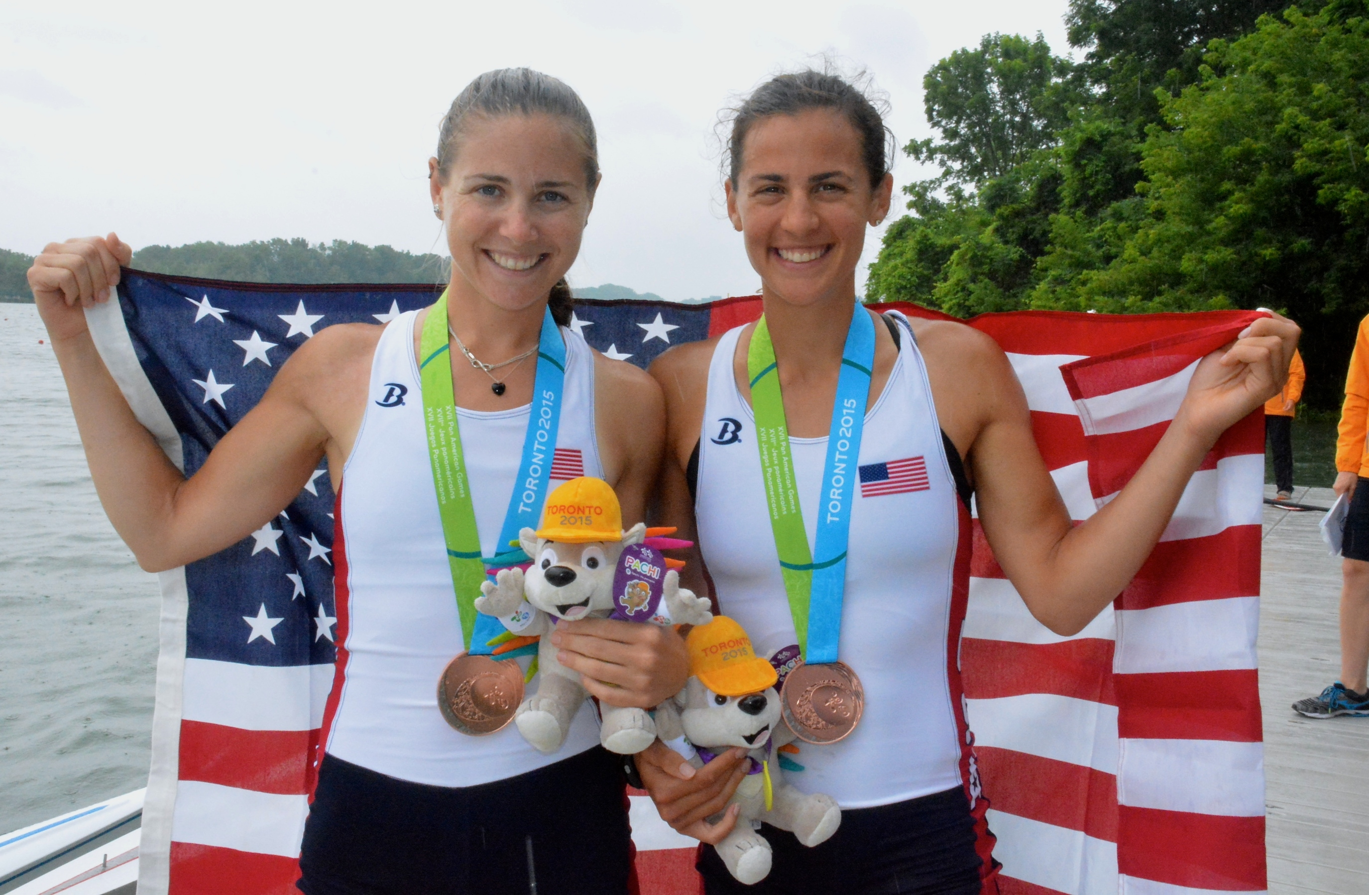 Buffalo native Sarah Giancola, right, celebrates her bronze medal Tuesday in the lightweight double sculls with partner Victoria Burke.