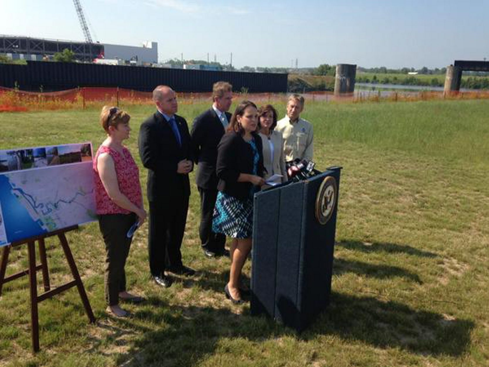 Officials at Monday's announcement of continuing Buffalo River project. (John Hickey/Buffalo News)