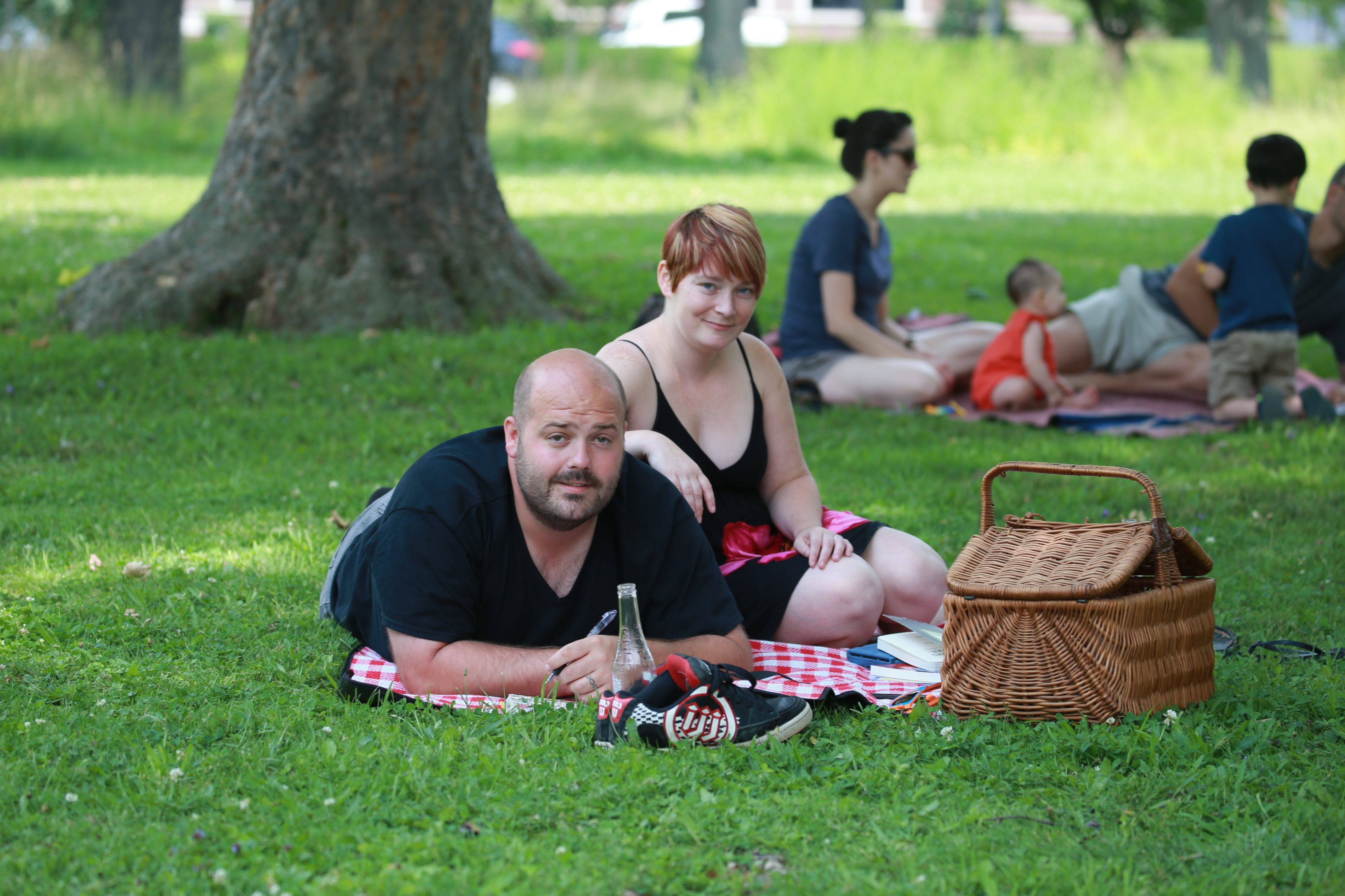Tim Chavers and his wife, Jacquie, of Lockport, are among about 100 people attending a picnic in Delaware Park, followed by a walk for peace, to set the tone for next month's Intune festival.