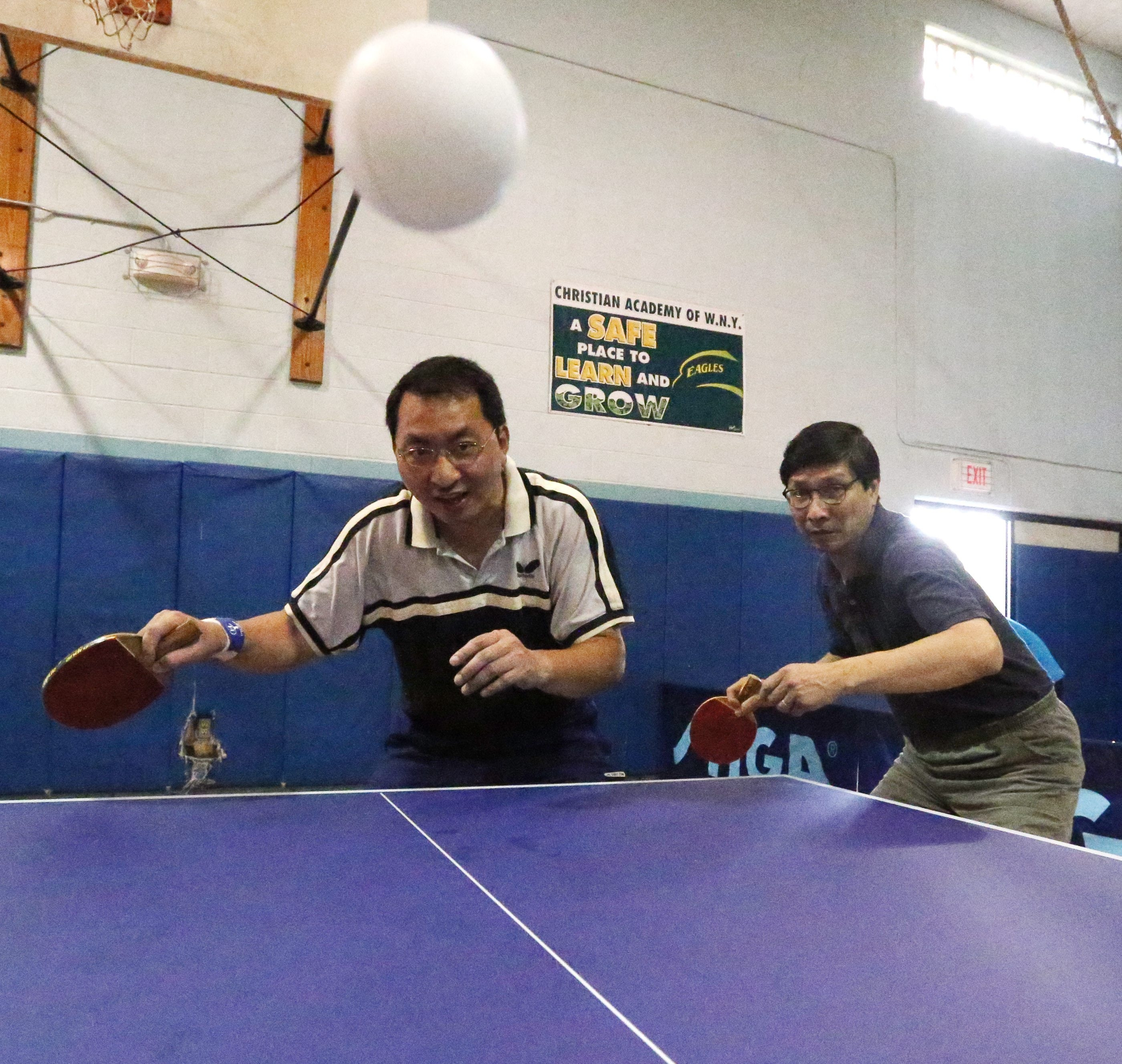 Yong Ren and Sunny Lee, two of the area's best at table tennis, team up for some doubles practice.