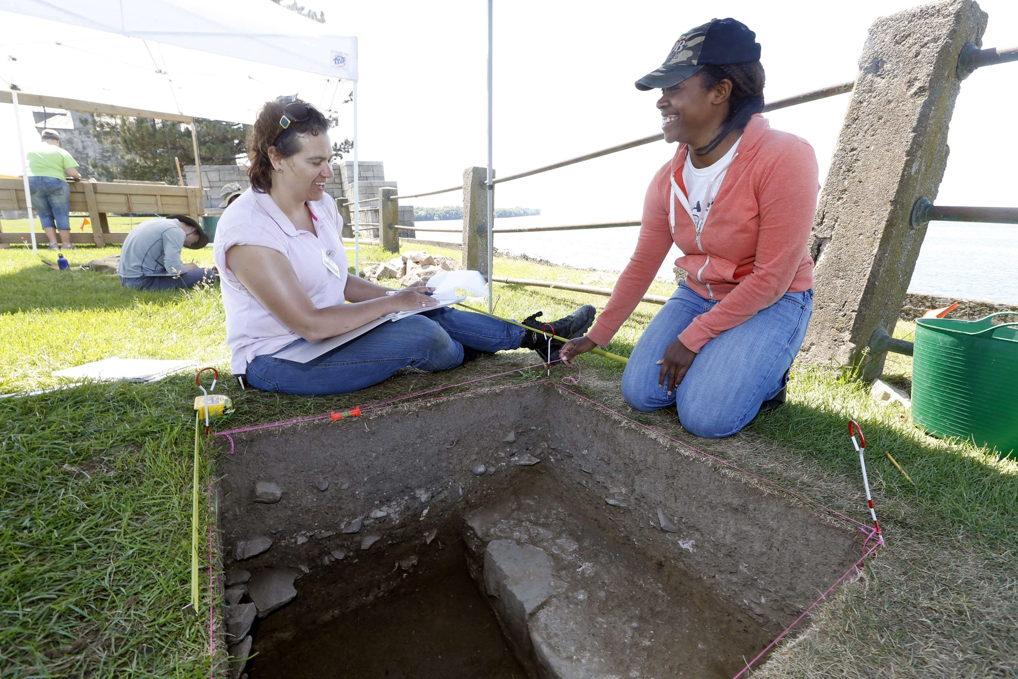 SUNY Buffalo State anthropology and archaeology students Wendy Borrelli, left, and Krystal Norman team at a dig next to 1726 French Castle at Old Fort Niagara. They are members of six-week project run by assistant anthropology professor Susan Maguire.