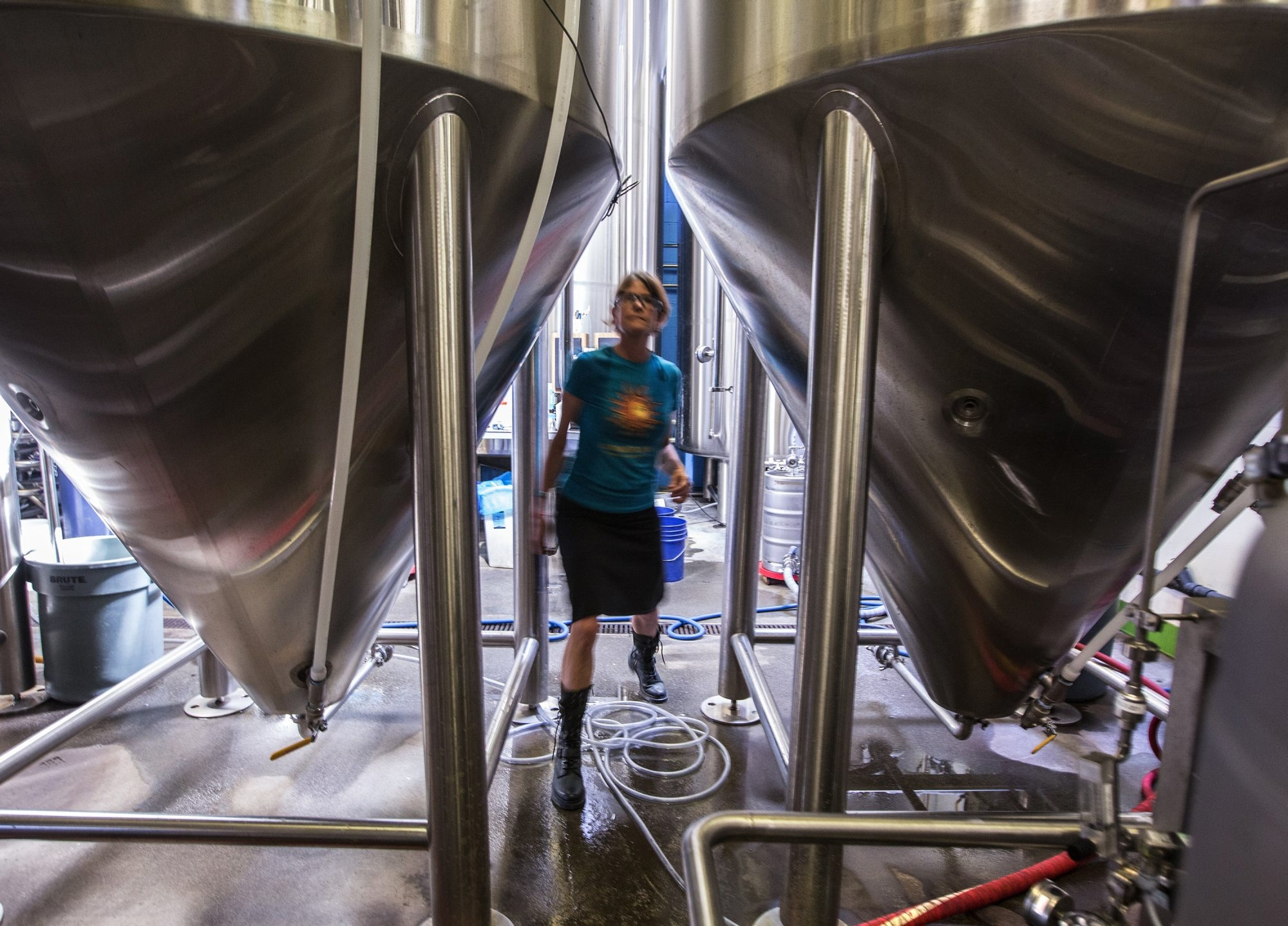 "Fremont Brewing's co-founder Sara Nelson inspects fermenters at the brewery. Proposals before Congress would reduce excise taxes, allowing Nelson to add another fermenter and hire one more employee. ""It's not small potatoes,"" said Nelson."