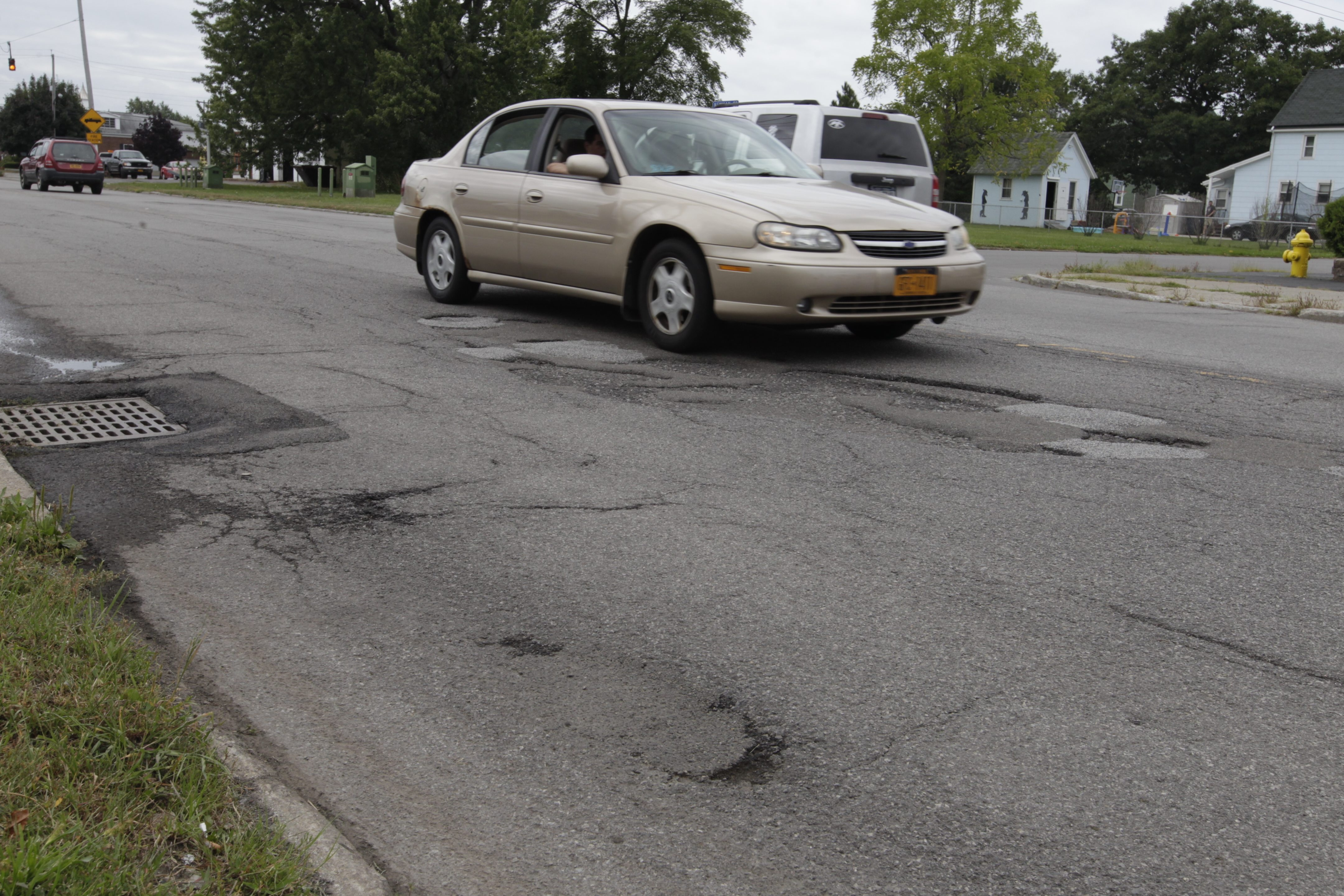 Potholes mar South Park Avenue in Lackawanna. Work is set to start on the road, which is near two of Erie County's most popular assets, Our Lady of Victory Basilica and the botanical gardens.