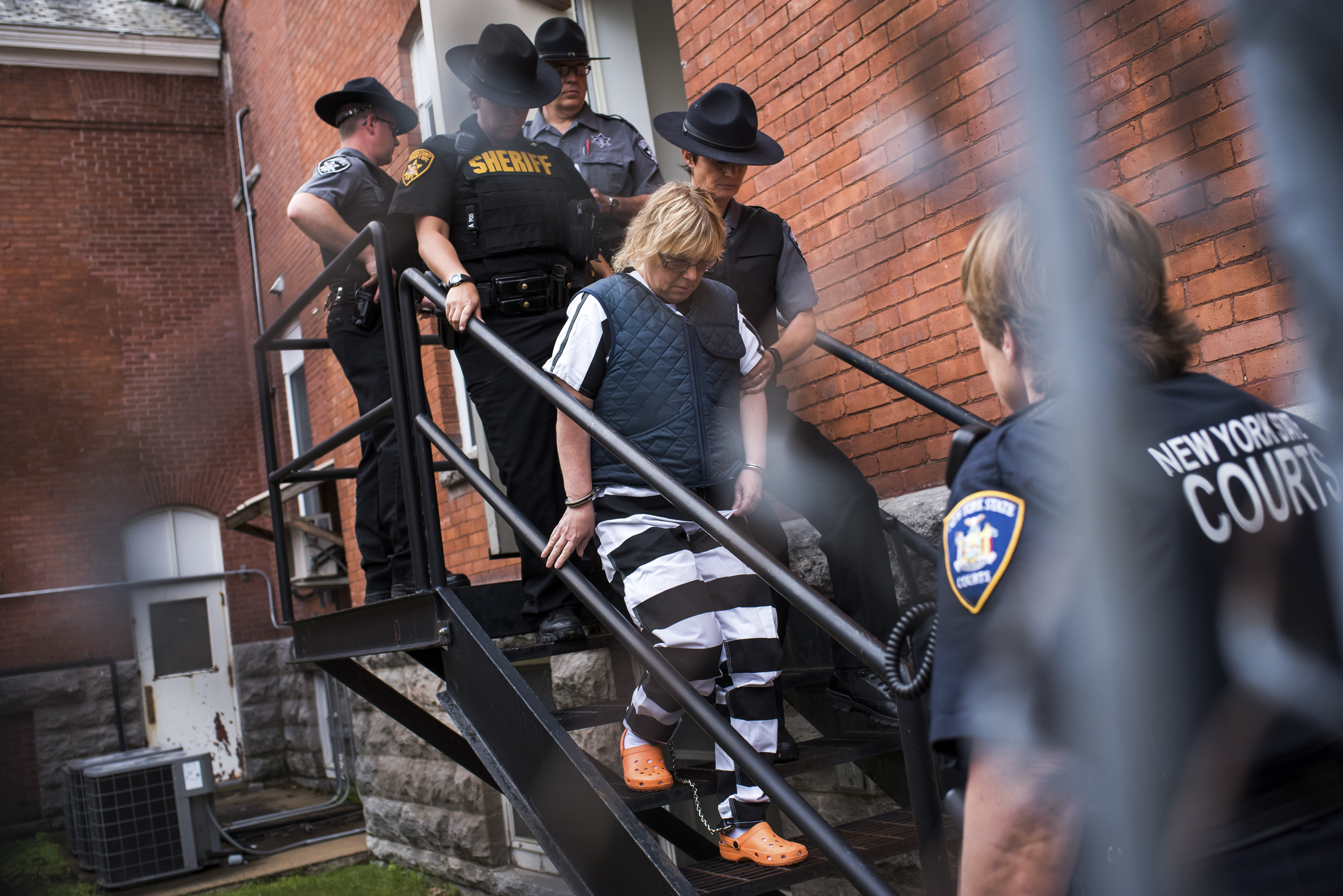 Joyce Mitchell, seen leaving a court hearing in Plattsburgh on June 15, was a supervisor in the Clinton Correctional Facility's tailor shop when she began an emotional relationship with David Sweat.