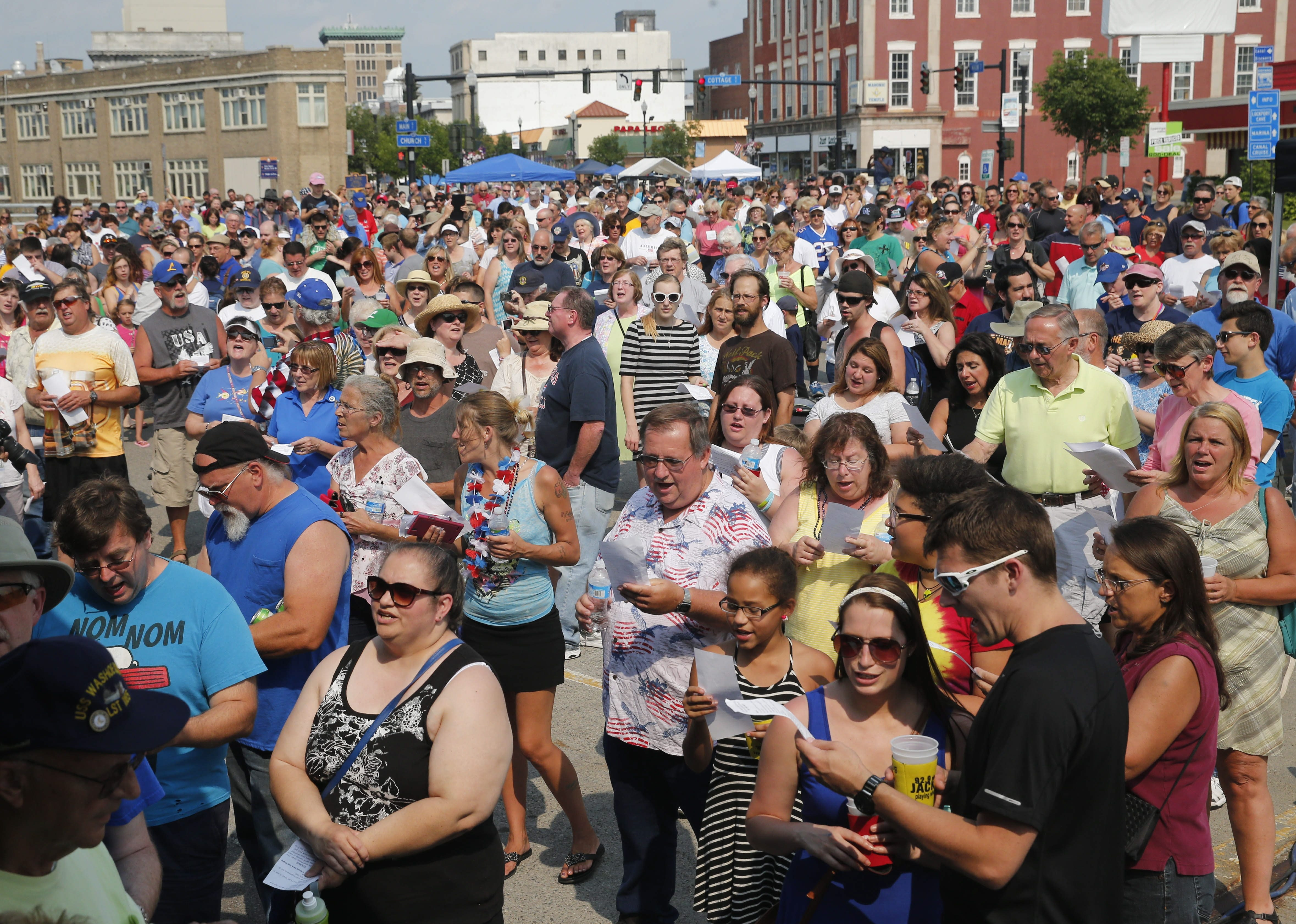 Although Lockport couldn't draw enough voices to break the Guinness World Record for most people singing live on a radio broadcast, the city celebrated its 150th birthday at the 15th annual Taste of Lockport Sunday.