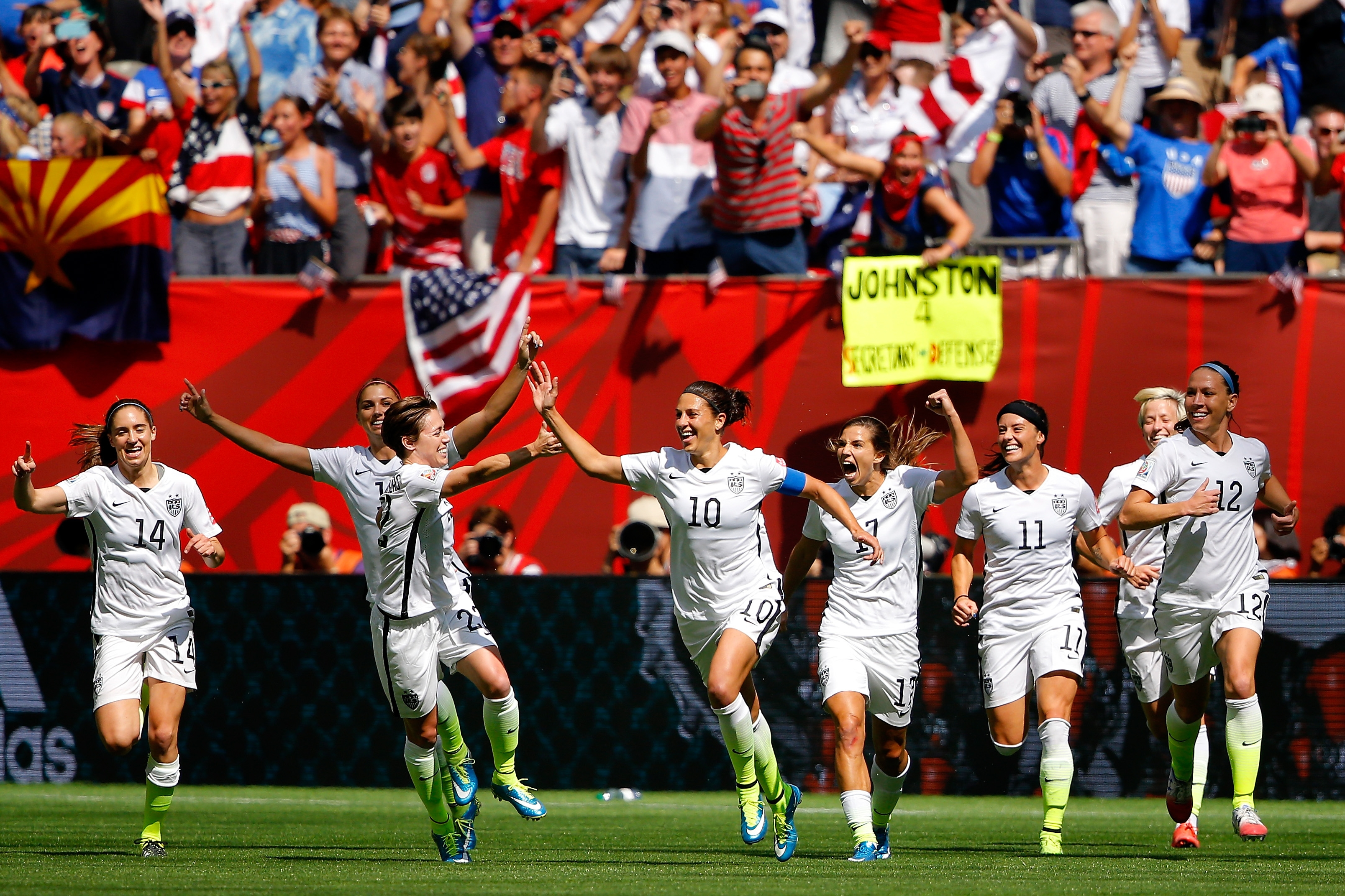 Carli Lloyd (10) celebrates with teammates after scoring her second goal against Japan in the 2015 Women's World Cup final.