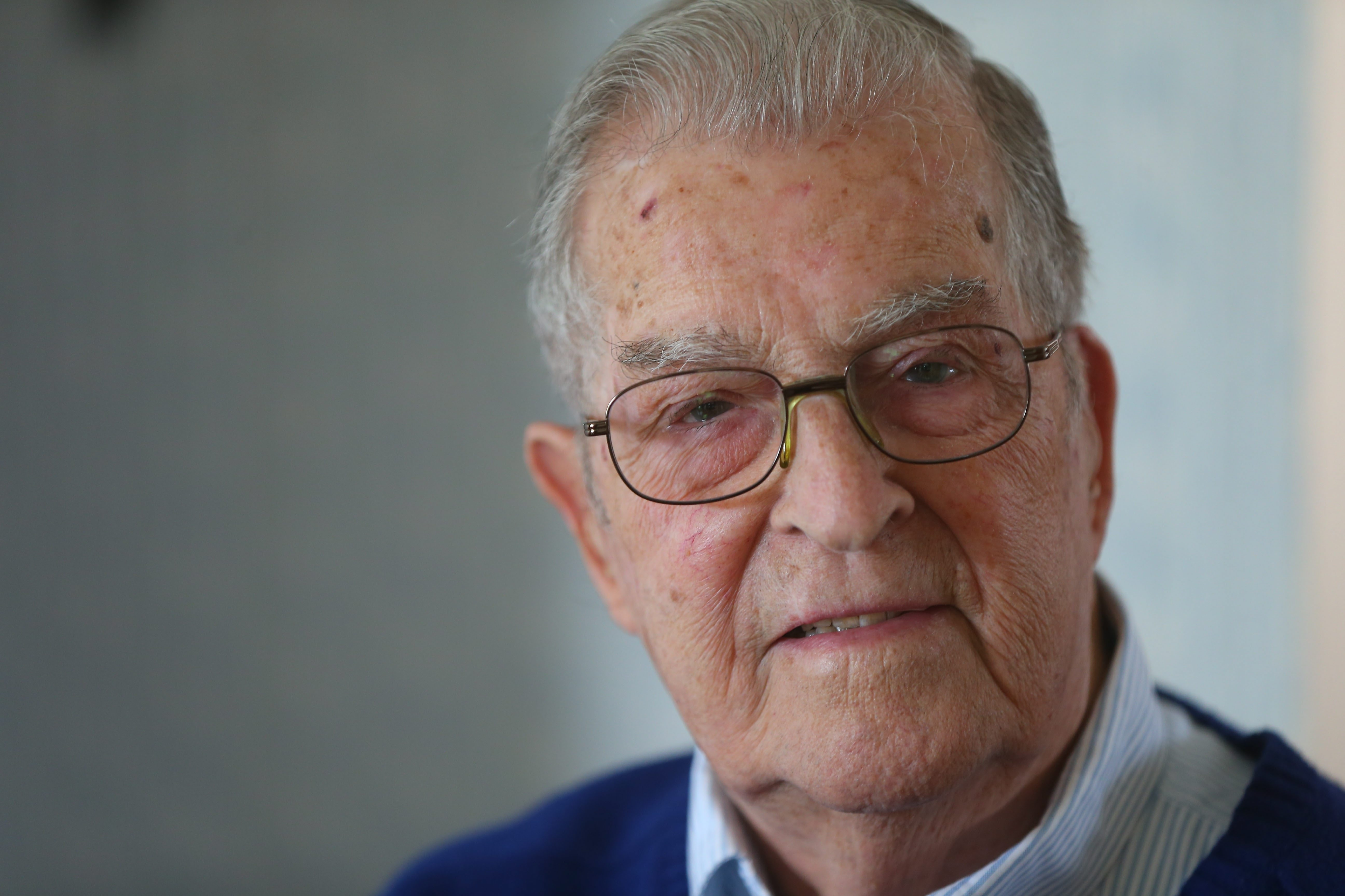 """World War II veteran Robert G. Mueller describes his wartime service as an airplane machinist mate as """"a Caribbean cruise."""""""
