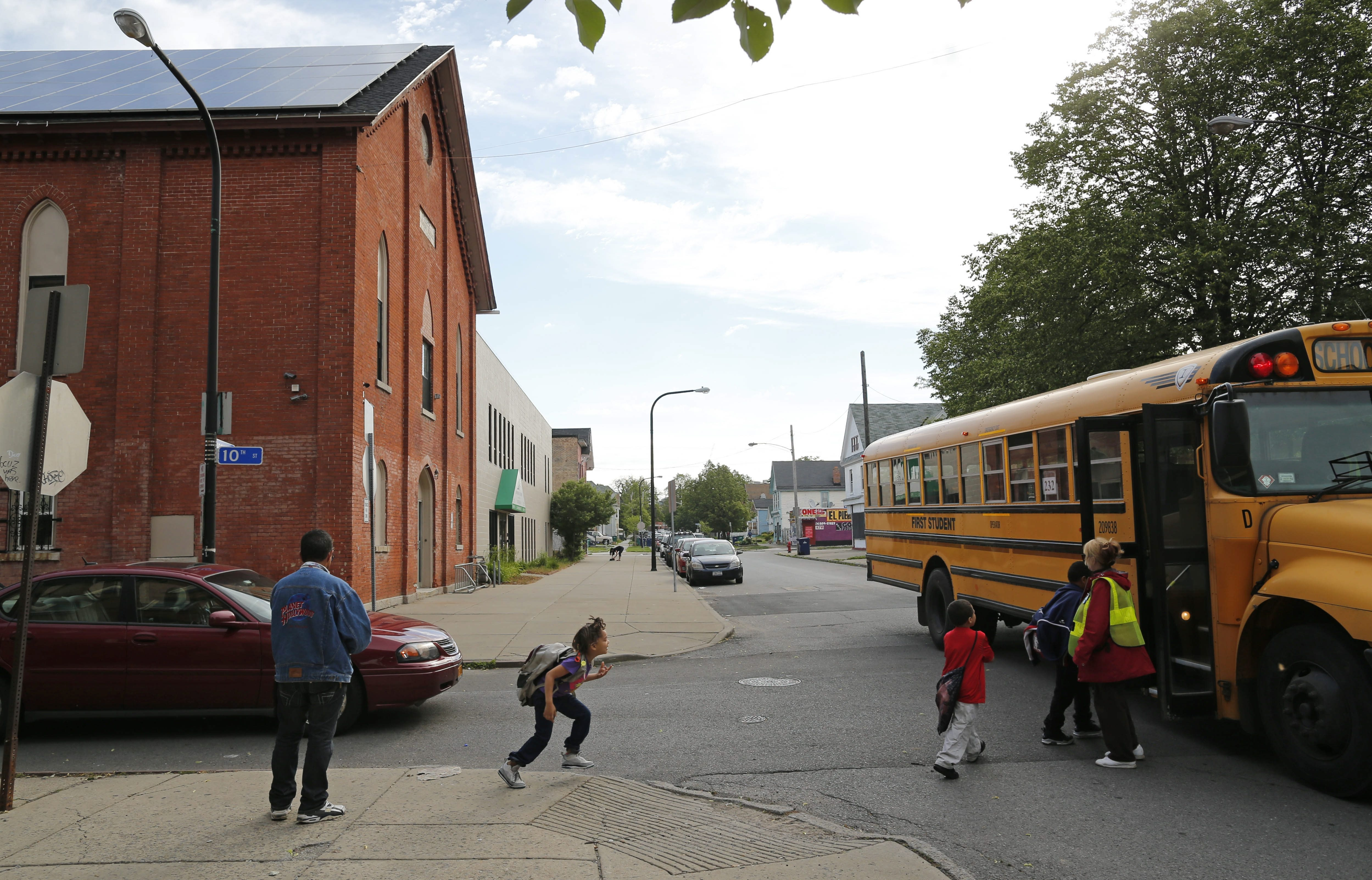 Children board the school bus on Virginia Street across the street from a methadone clinic that opened up eight months ago, Wednesday, June 17, 2015.  (Derek Gee/Buffalo News)