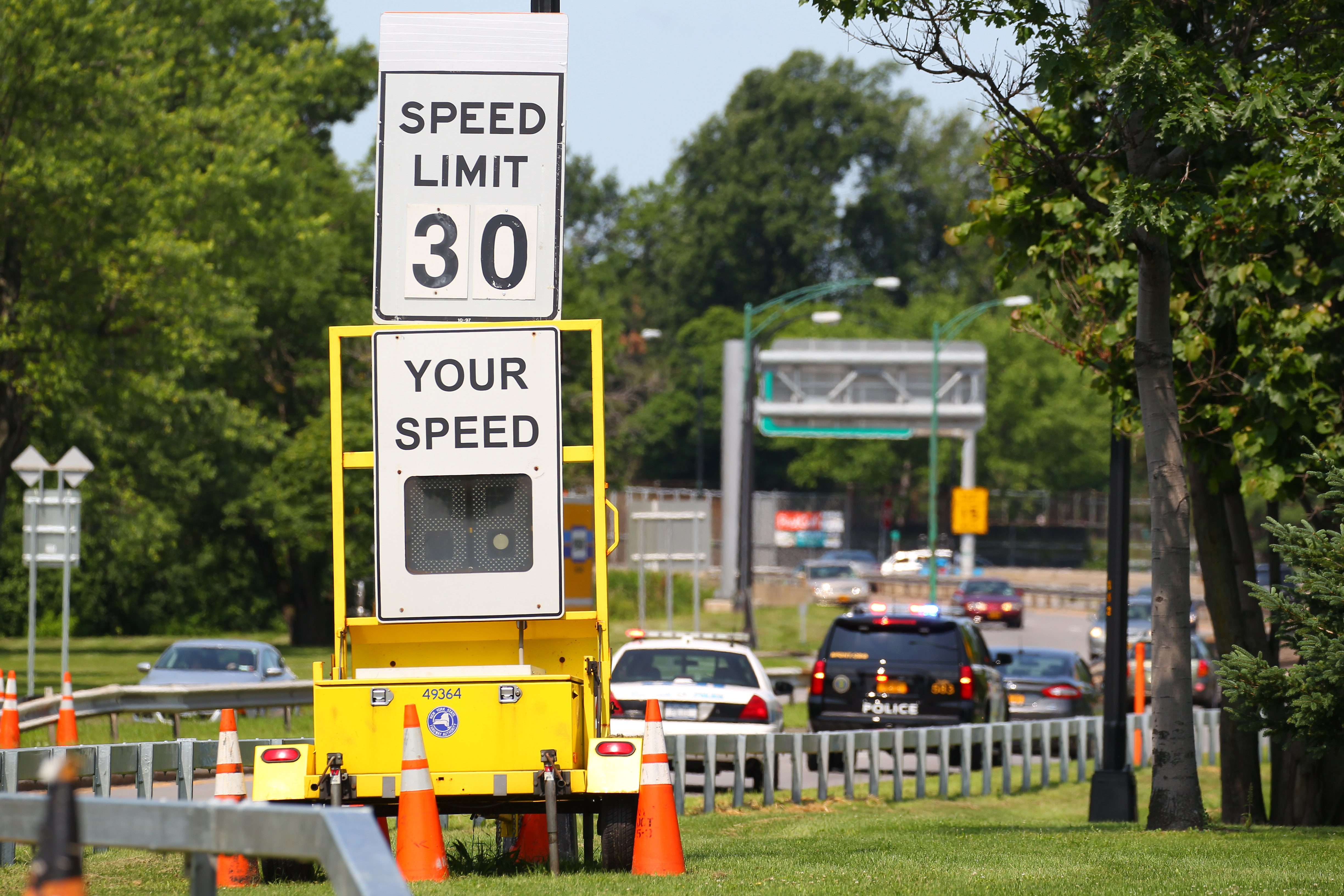 Speed monitoring signs display drivers' speed on the Scajaquada Expressway Friday in Buffalo. Some residents want faster speeds restored in areas away from Delaware Park.