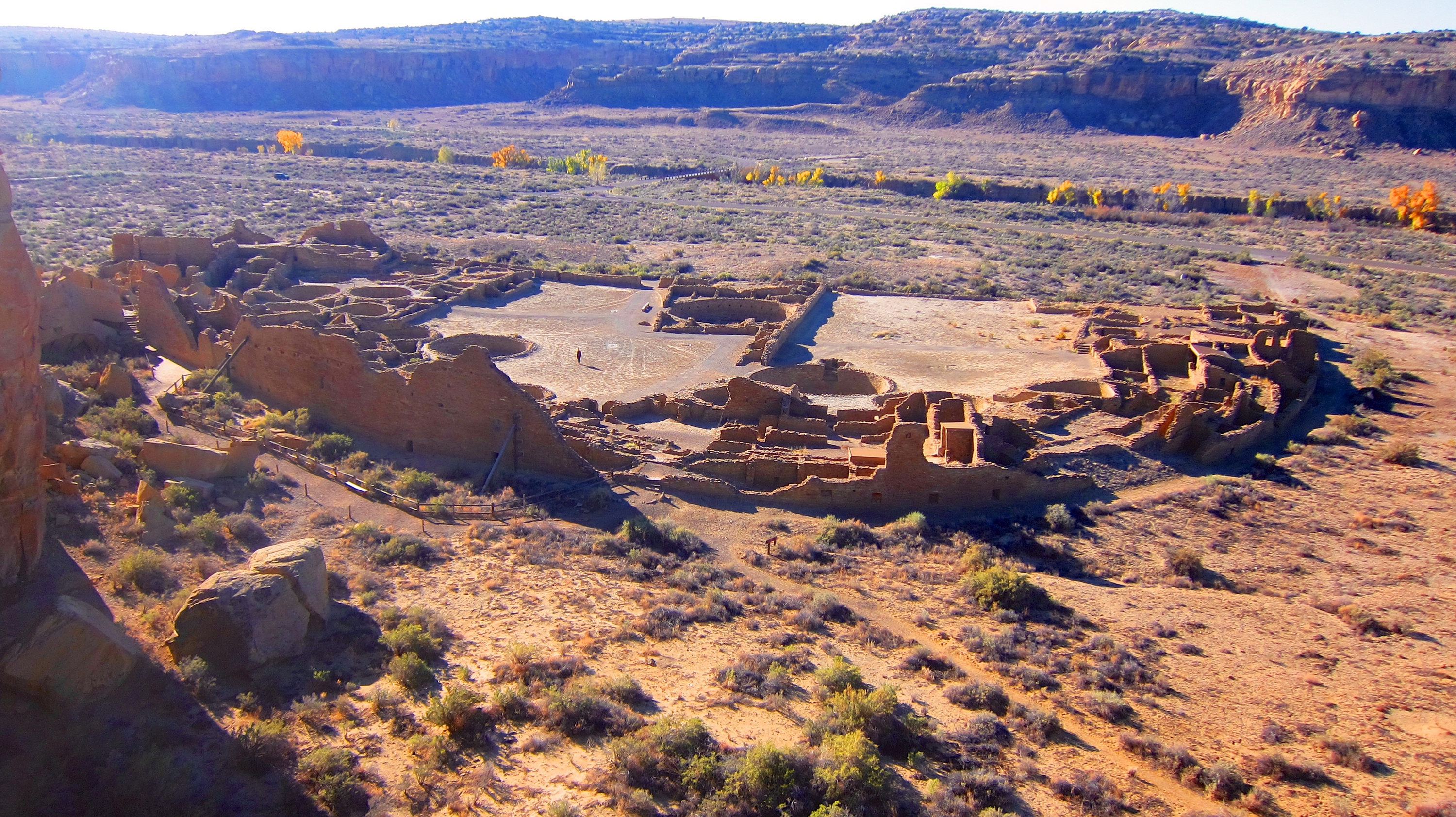 Pueblo Bonito, one of the biggest archaeological sites at Chaco Culture National Historic Park, is seen from a cliff.