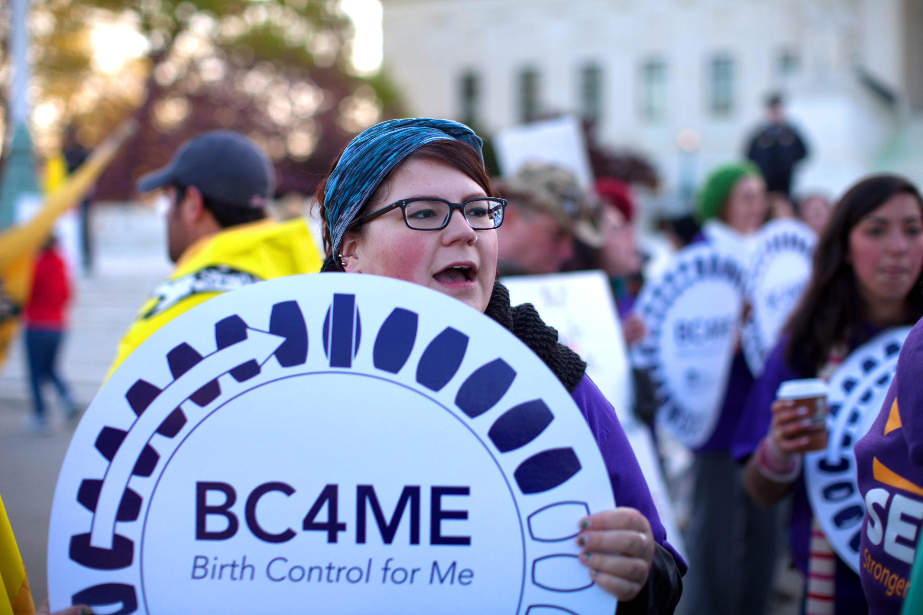 A demonstrator holds a sign supporting birth control outside the Supreme Court in Washington, D.C. Some say oral contraceptives should be available without a prescription.