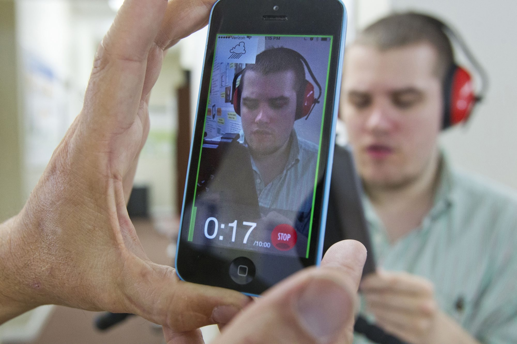 """One of the video apps is a tutorial and guide """"to capture the right stuff so that doctors can make a quicker assessment or diagnosis,"""" says Ron Oberleitner, demonstrating with his son, Robby. The app works on phones or tablets. (Katherine Jones/Idaho Statesman/TNS)"""