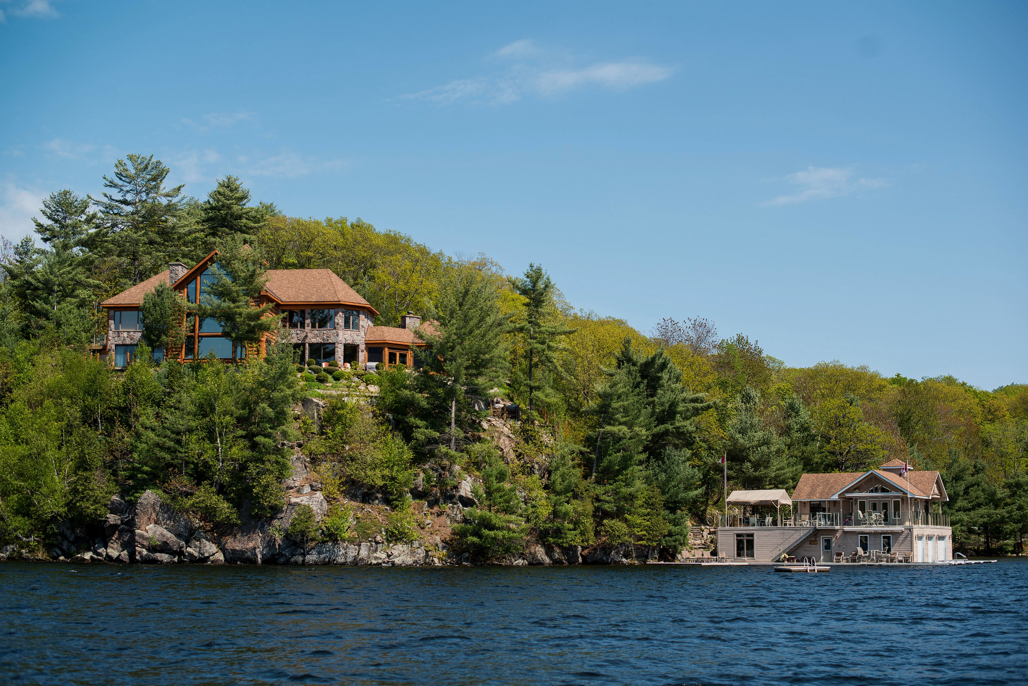 A large cottage stands on Lake Rosseau in Muskoka, Ont. Muskoka, once given away for free by the Canadian government and now a treasured spot for the titans of business, is attracting American investors who want a rustic retreat that comes with 800-thread-count sheets.