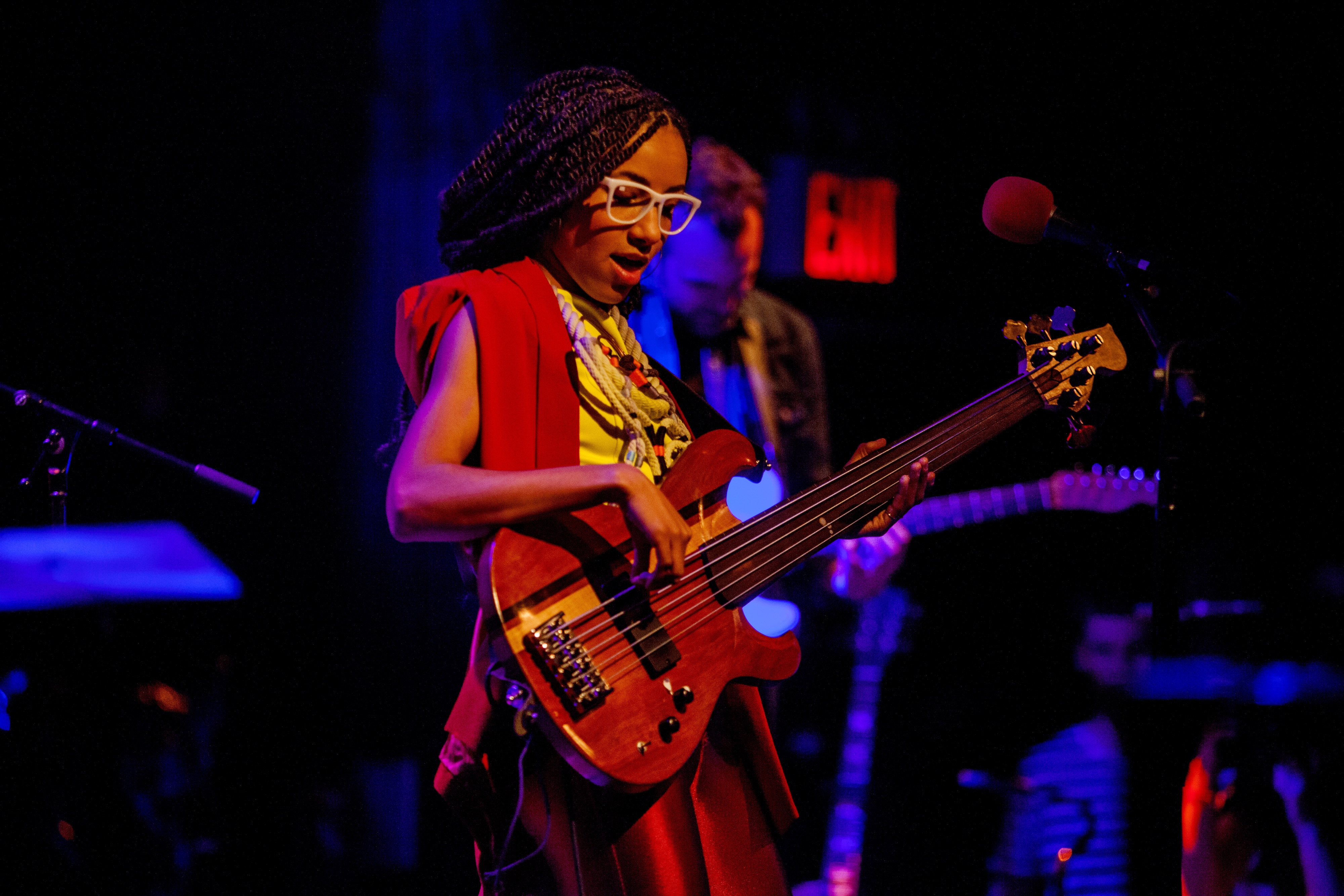 "Fashion has become a storytelling tool for Esperanza Spalding, shown in May in New York. ""Since I was never concerned with dressing up and looking fabulous, when I realized it was going to be part of my life, I wanted to find a way to make it interesting to me,"" she said."