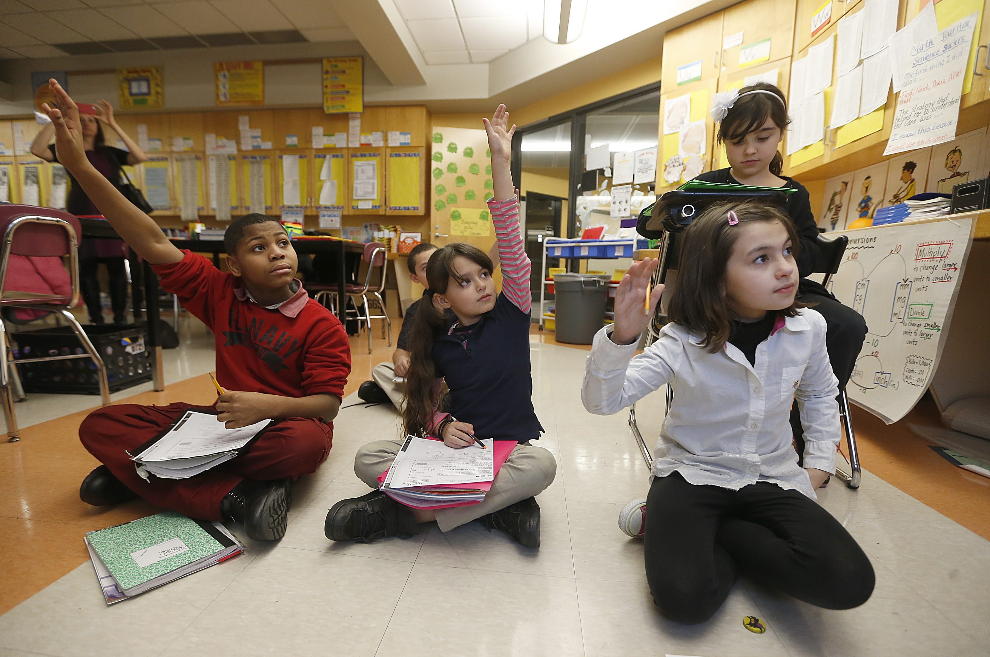 Students show, in this file photo, that they're not done learning for the day as they take advantage of after school academics at William J. Grabiarz School of Excellence.  (Robert Kirkham/Buffalo News)