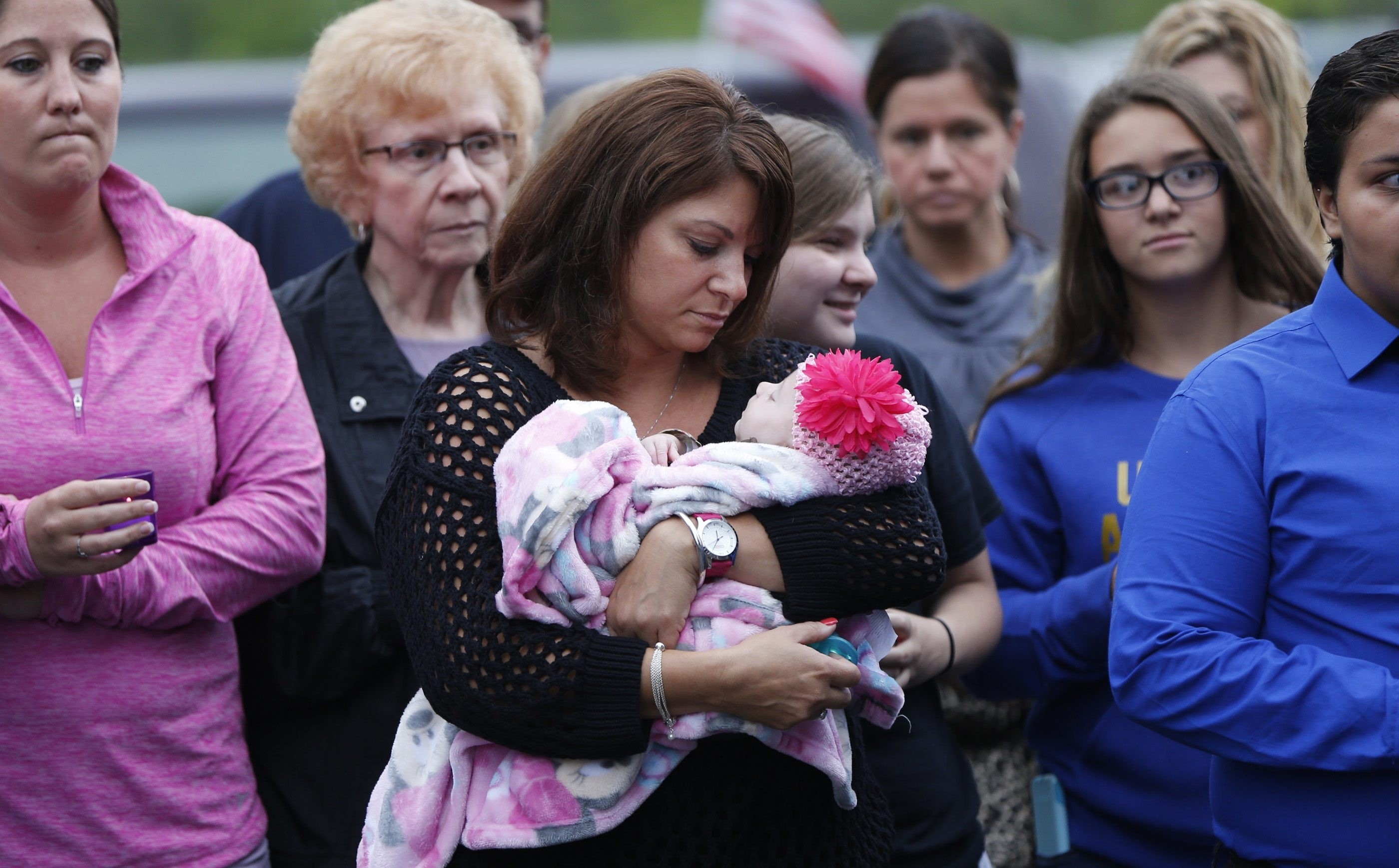 Andrea Kwasniewski holds her granddaughter  Mayci during a vigil for daughter Ashley Whiting.