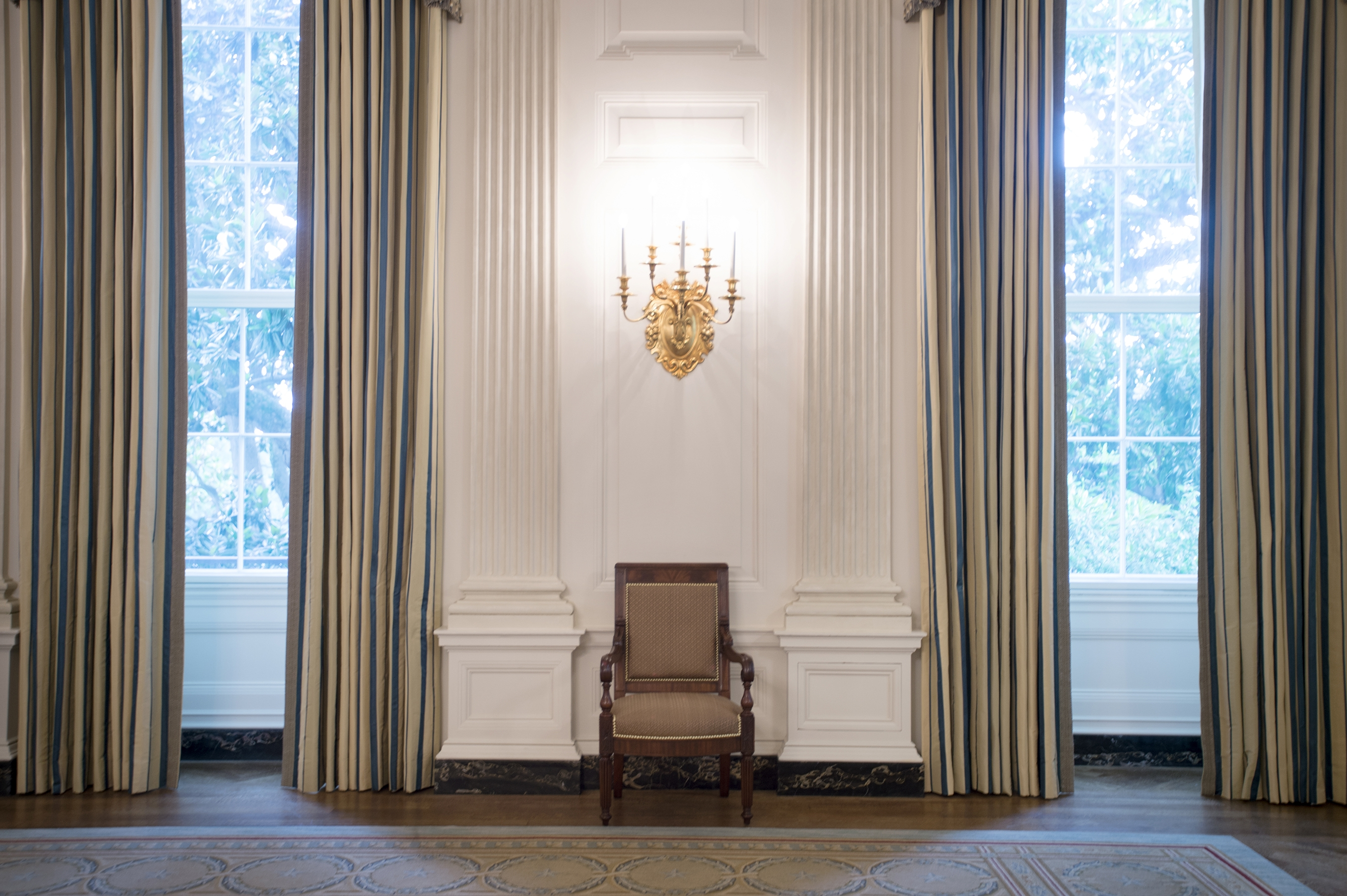The makeover of the White House State Dining Room dressed up the space with sumptuous new silk curtains, a set of 34 new mahogany chairs inspired by ones from the Monroe era and a new paint job that highlights the architecture in the room.MUST CREDIT:  Washington Post photo by John McDonnell)