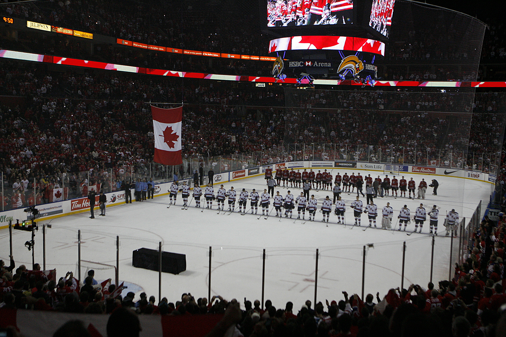 The Canadian flag is raised after Canada's semifinal victory over the United States at the 2011 World Juniors at First Niagara Center. (John Hickey / Buffalo News)