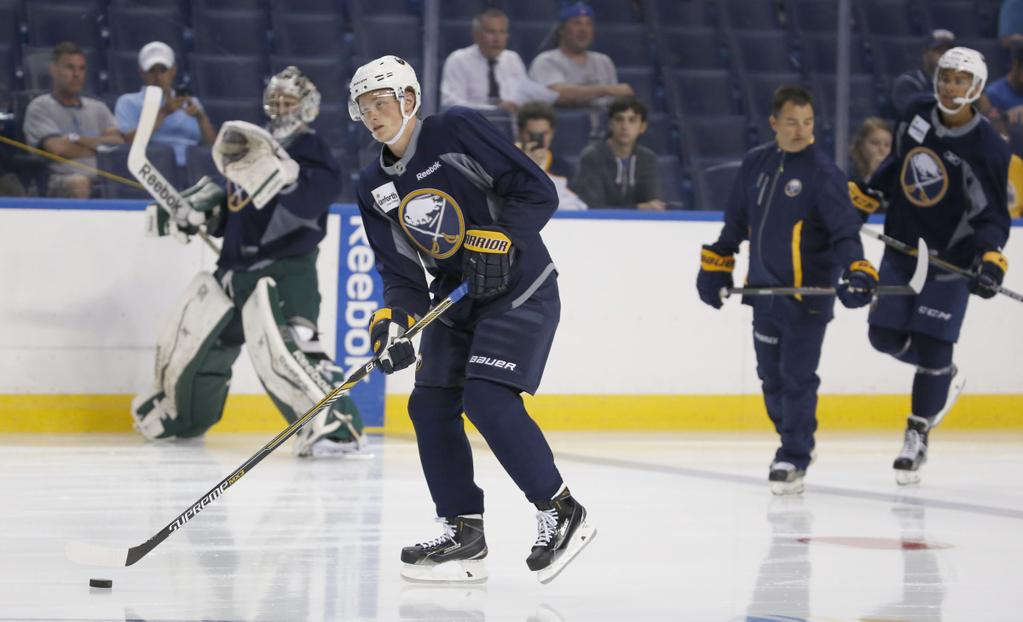Jack Eichel takes to the ice for the first time as a Buffalo Sabre at the team's development camp. (Harry Scull Jr./Buffalo News)