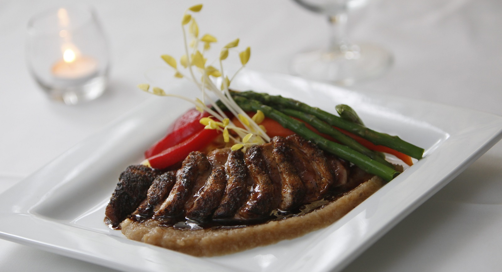 Crisp duck breast with house pasta, roasted pear puree and raspberry coulis from Daniels restaurant.  (Sharon Cantillon/Buffalo News file photo)